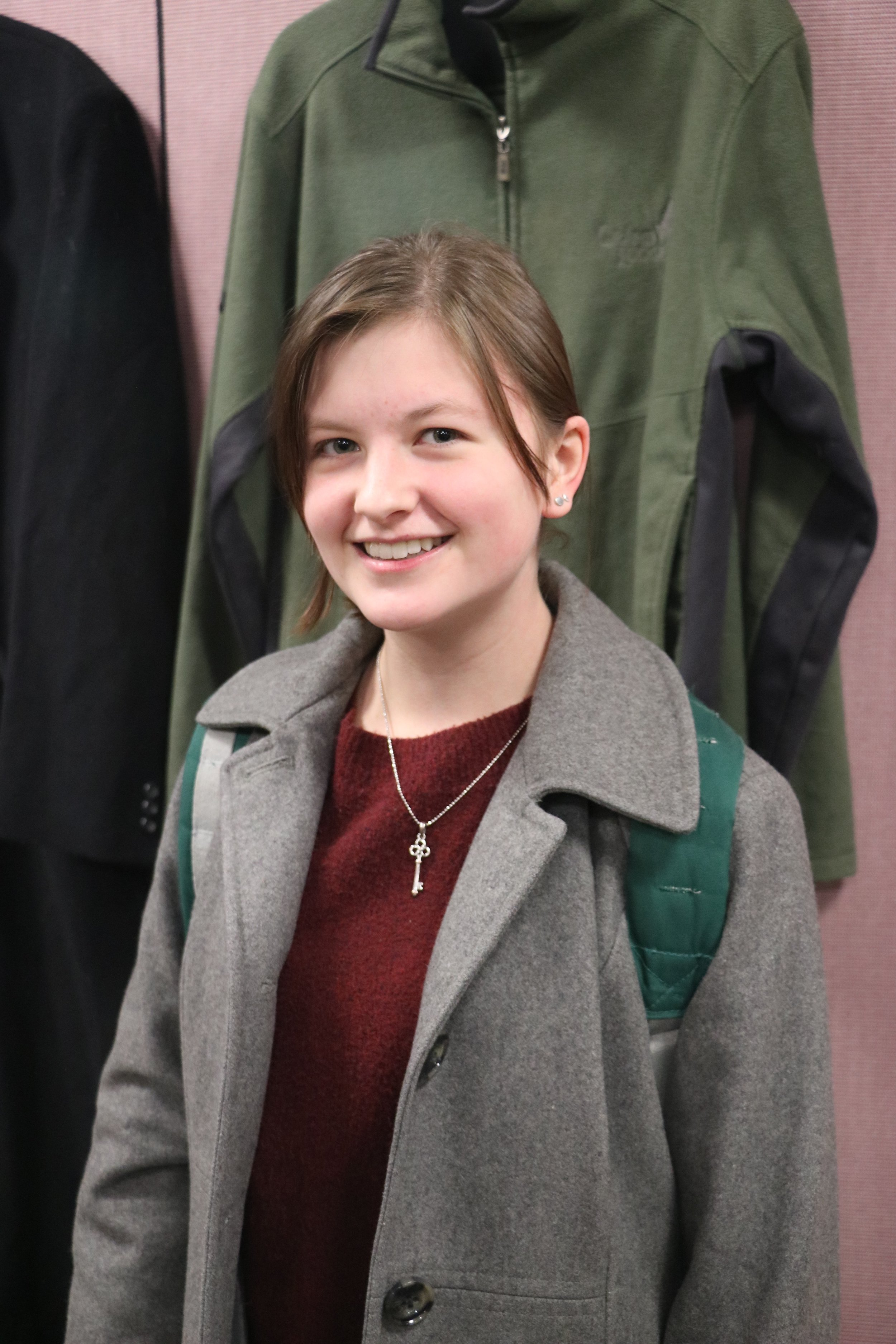 Lexie Ward at the Free Store on Nov. 1, 2018. Ward found a jacket to take home for free at the store. Photo by Rebecca Kottke