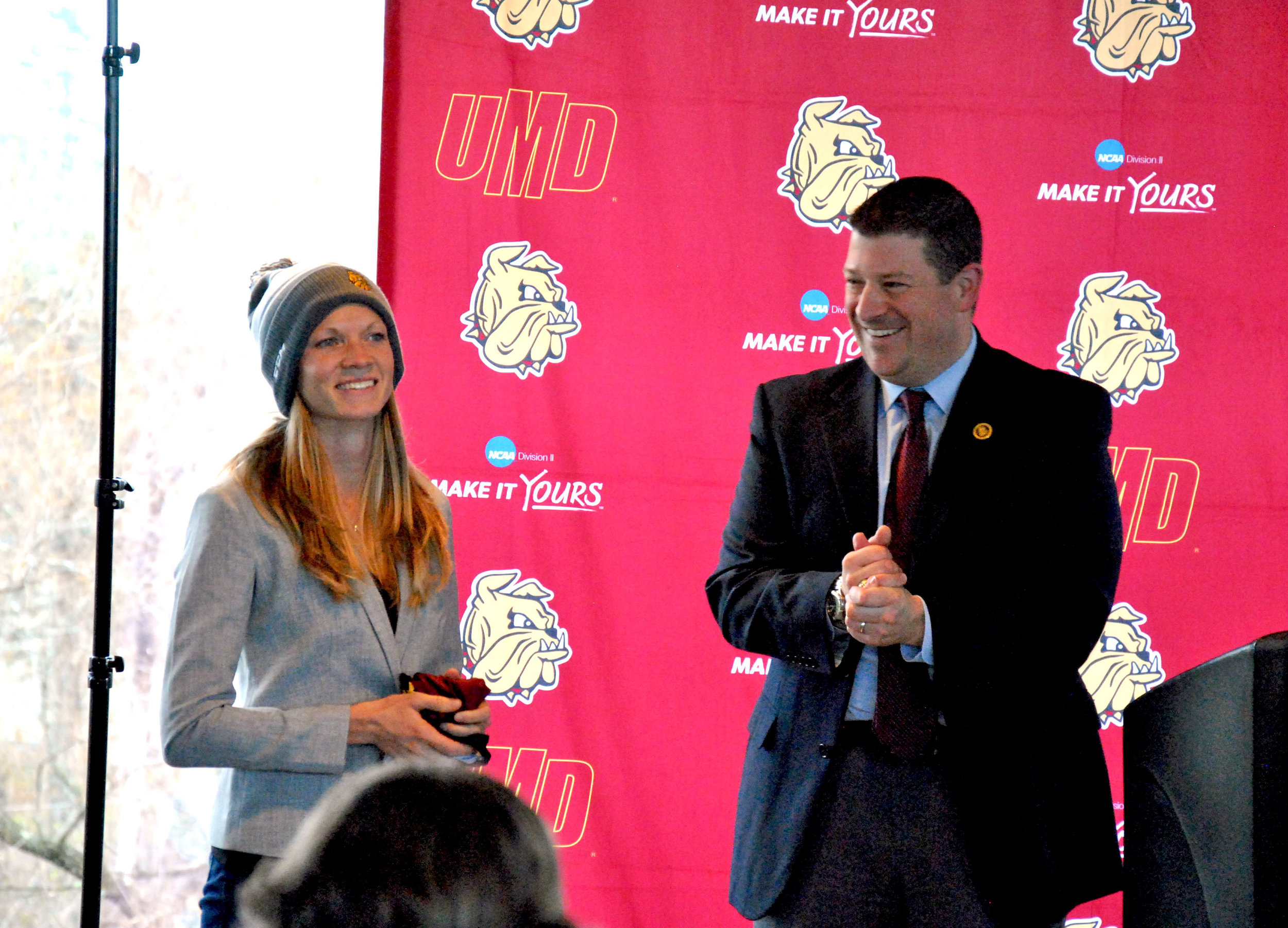 Harmon has coached the past three years in California and received a hat as a welcome gift. Photo by Rebecca Kottke