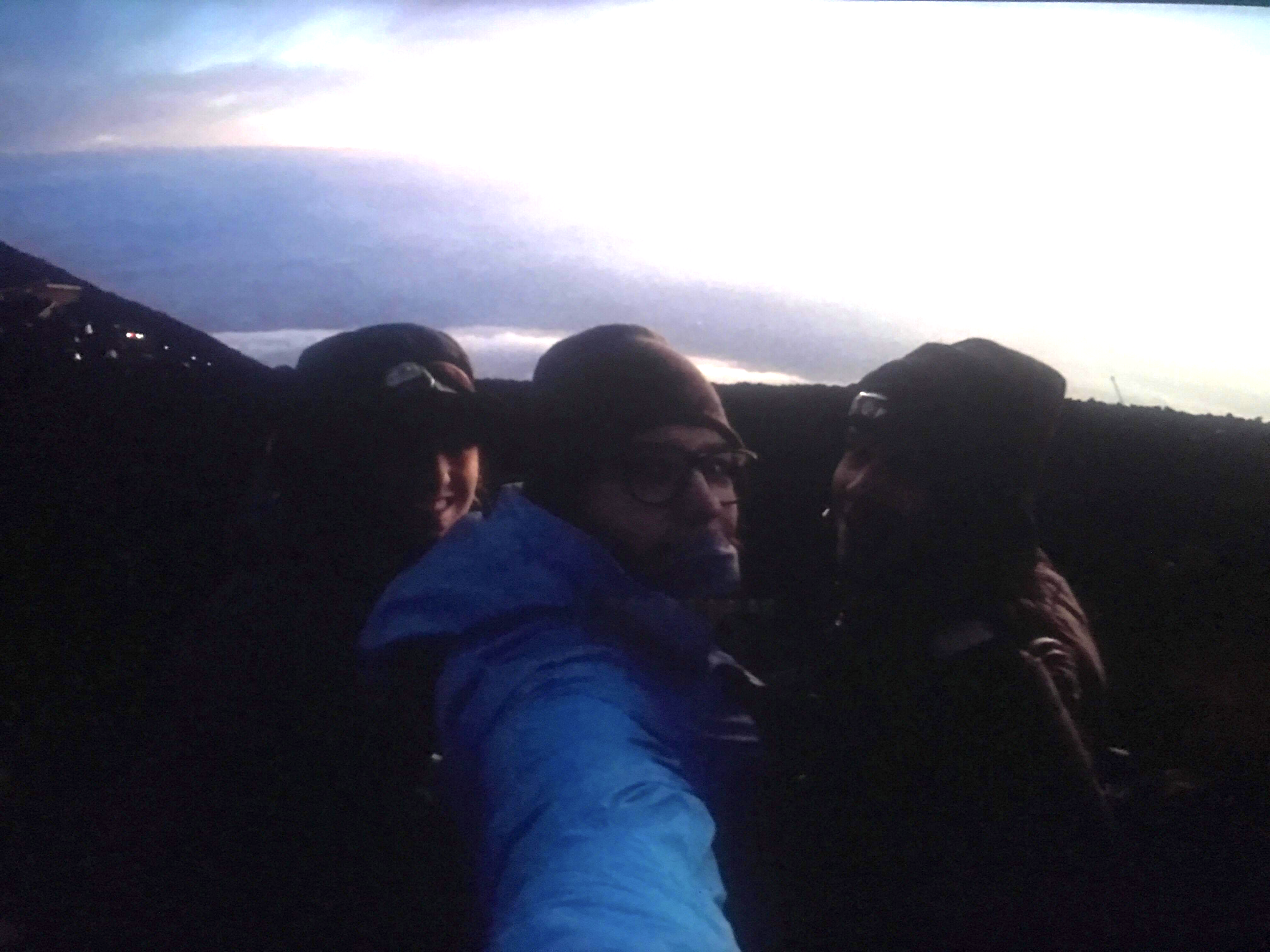 Mary Franz, along with her siblings Paul and Sarah, smile at the summit of Mount Fuji. Photo courtesy Mary Franz