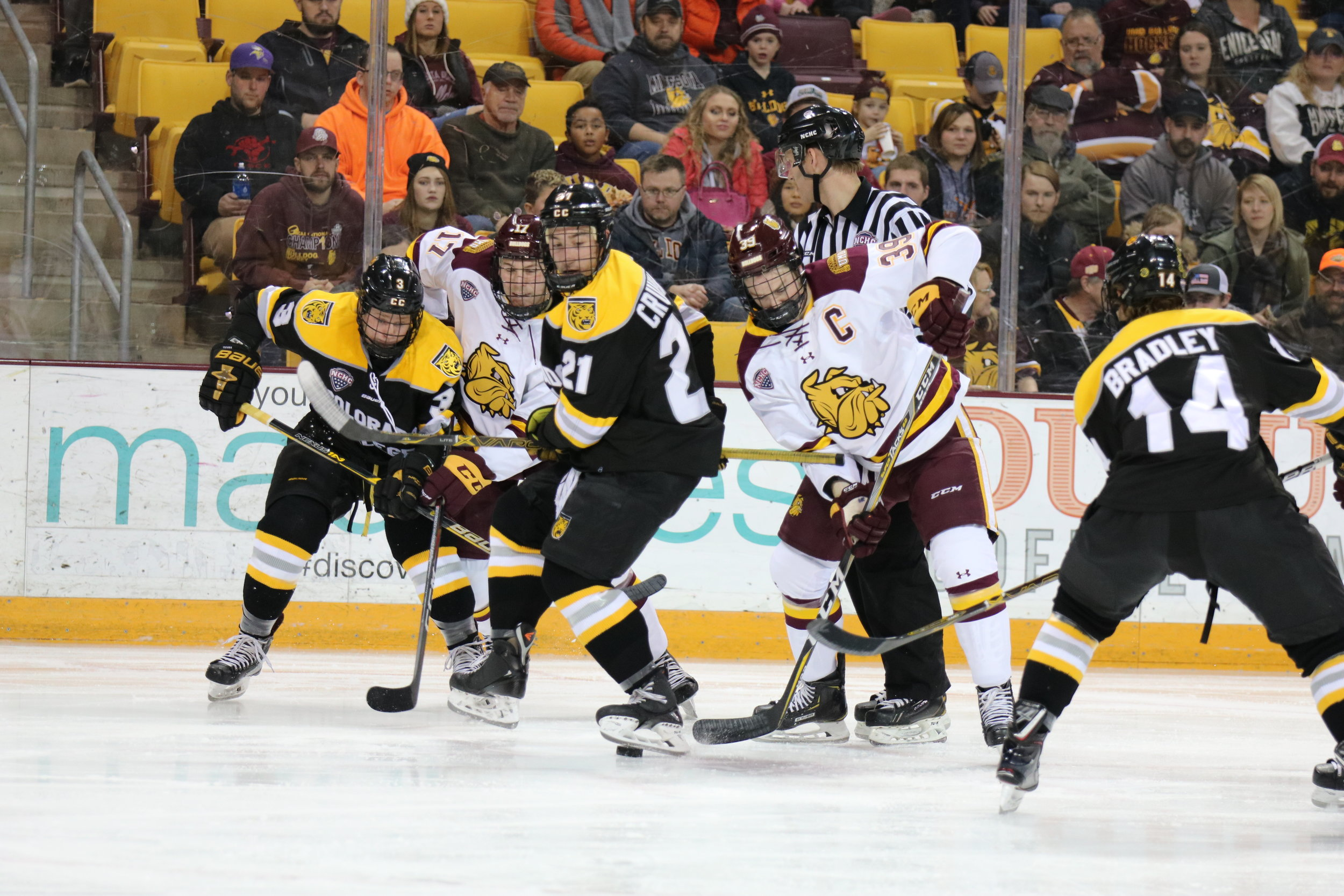 Minnesota Duluth players chase the puck from Colorado College players. Photo by Drew Smith