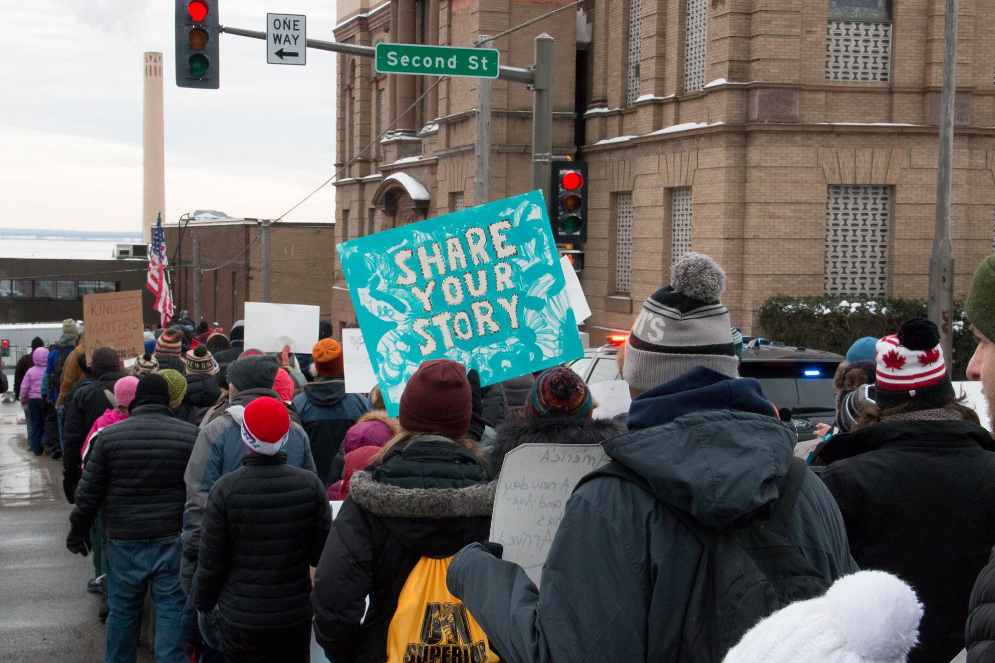 The group marched down 1st Ave. East Monday morning. Photo by: Ivy Vainio.
