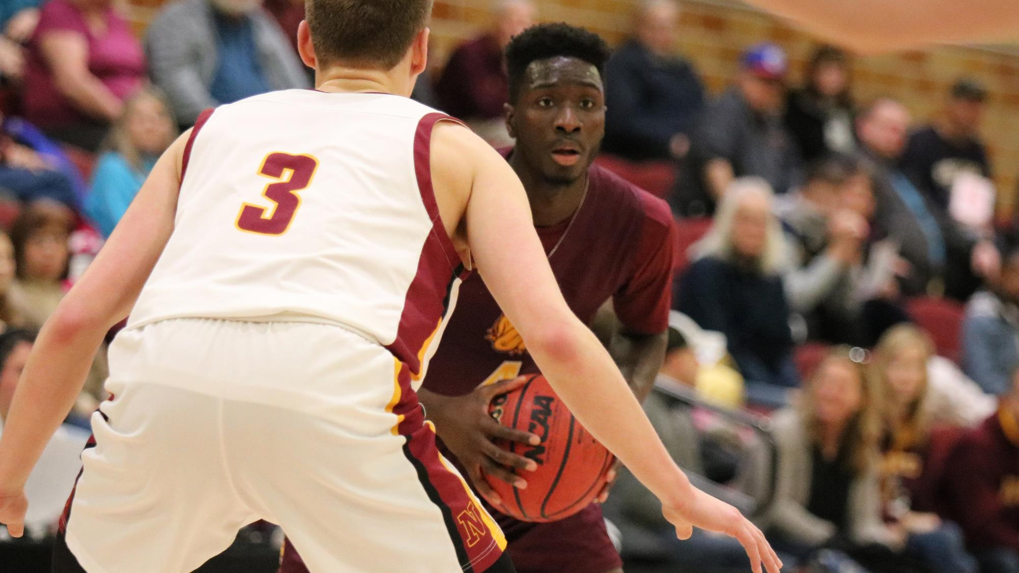 Senior Mamadou Ngom defends against a team member from Northern States. Photo by Drew Smith, courtesy of UMD Athletics