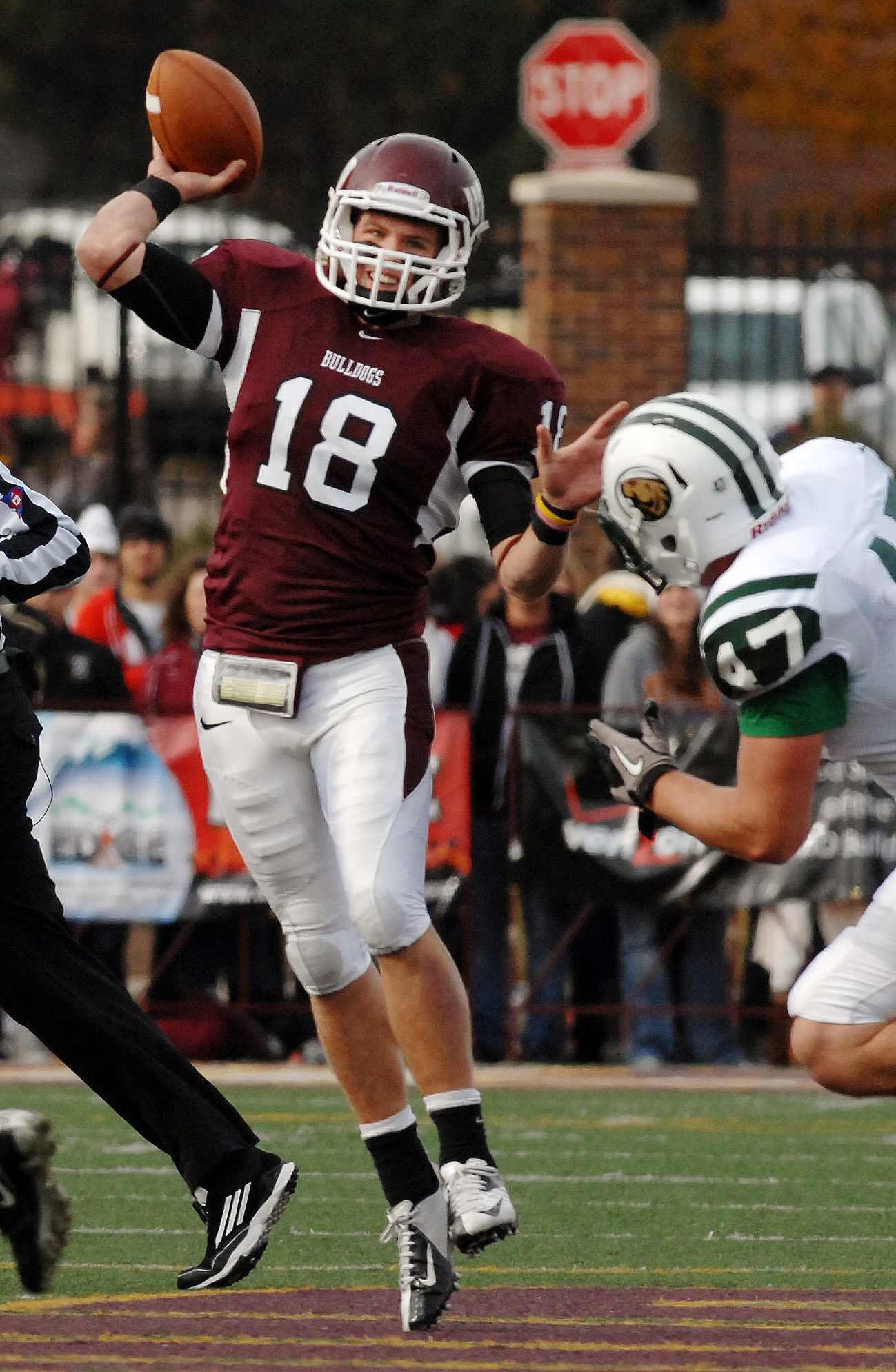 Vogler (18) attempts a pass against Bemidji State. Photo courtesy: UMD Athletics