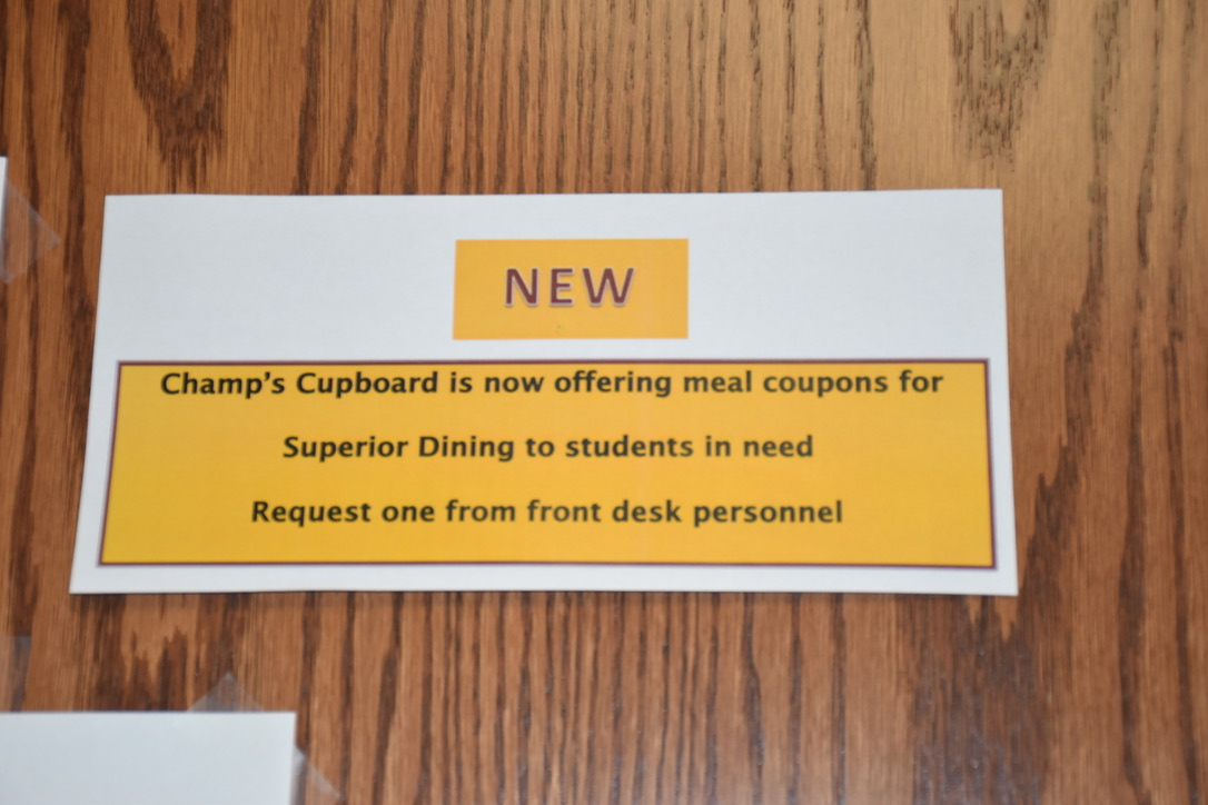 Signage inside the Cupboard indicates the new coupons available to students. Photo by Heidi Stang
