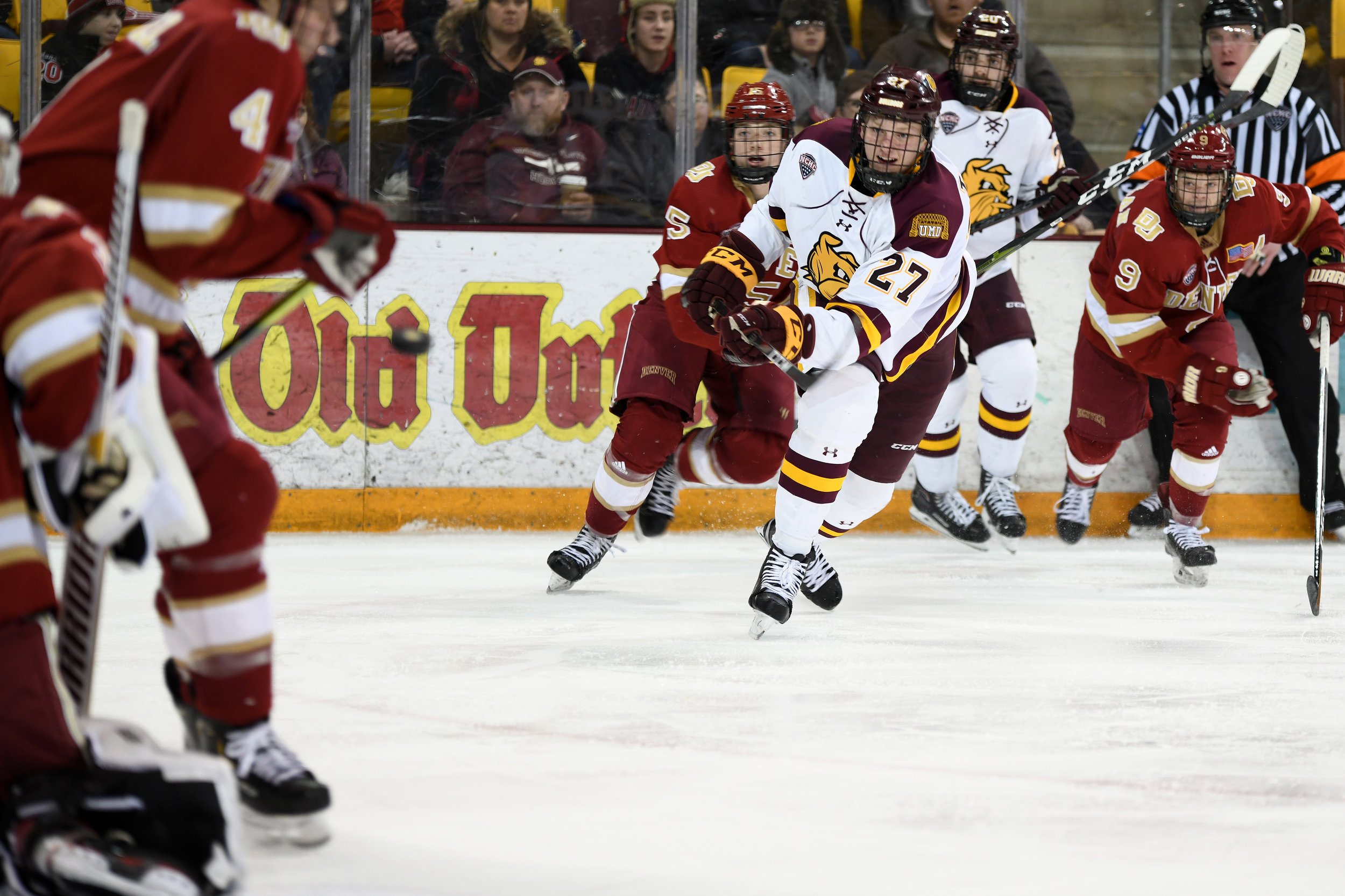Junior wing Riley Tufte (27) passes the puck Friday night at AMSOIL Arena. Photo: Terry Norton