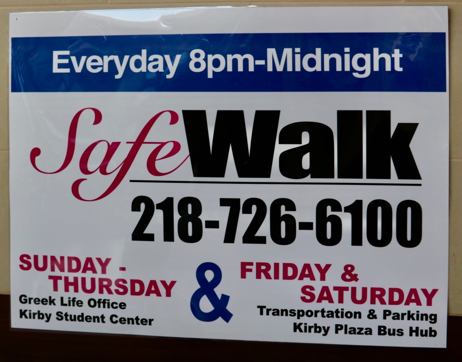Safewalk sign located near the Bus Hub. Photo by Madison Hunter