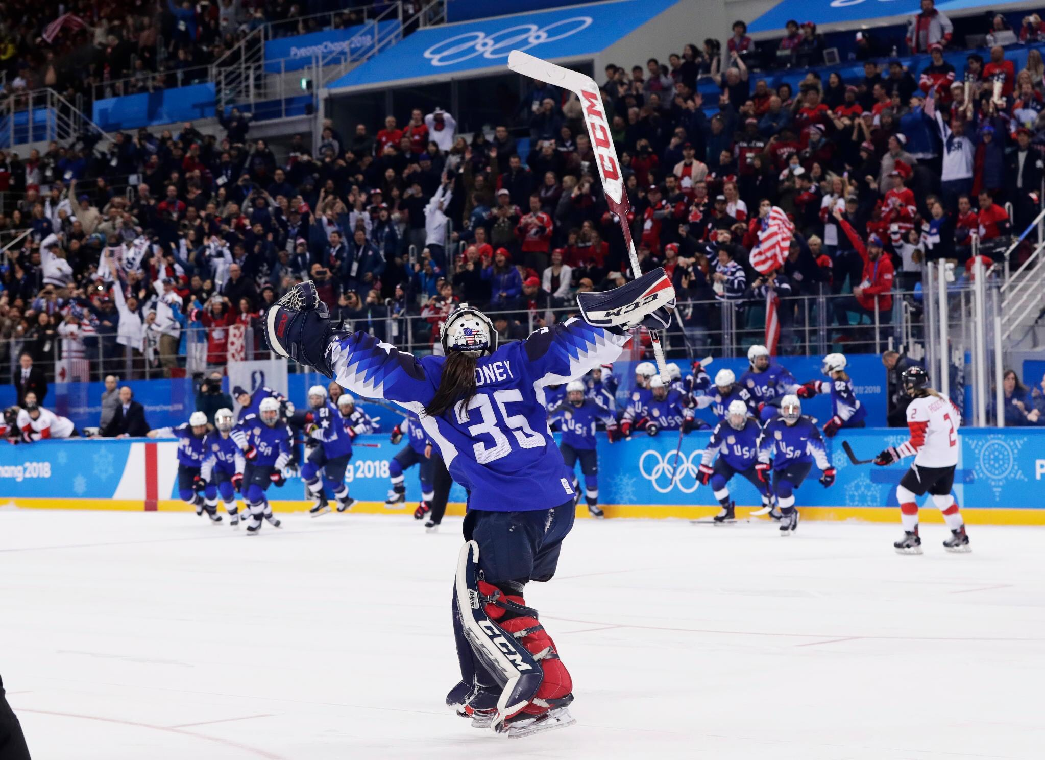 Rooney celebrates winning gold after stopping Canada in a shootout. Photo courtesy of Maddie Rooney