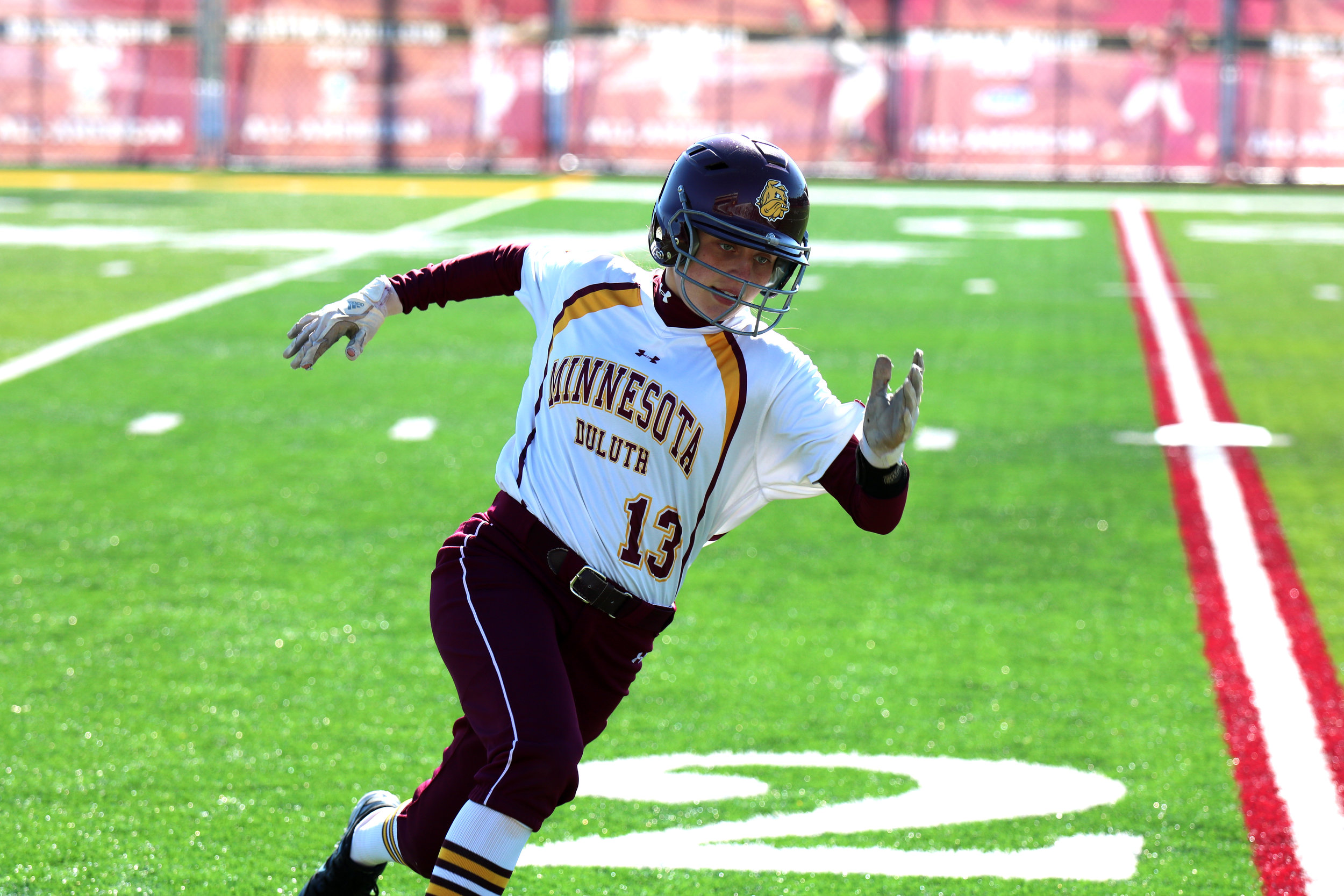 Junior outfielder Lauren Greeder runs the bases against St. Cloud State. Photo by: Drew Smith