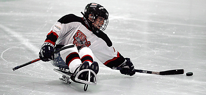Sled hockey player. Image courtesy of Wikimedia commons.