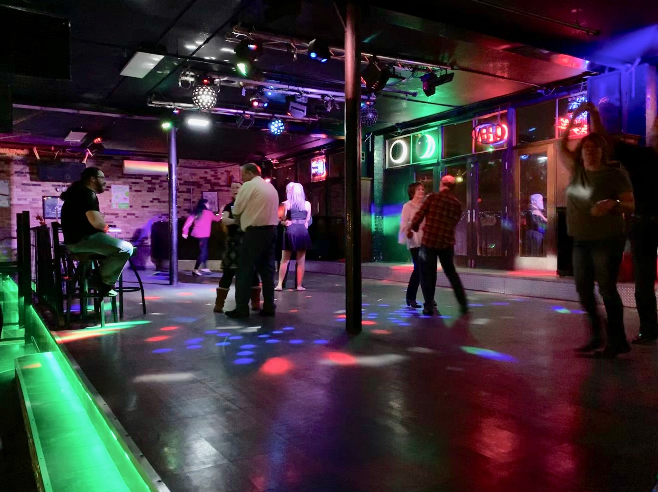 Community members come out every second and fourth Tuesday of each month to swing and line dance at The Flame nightclub. Photo courtesy of Tyra Jaramillo, who accompanied me.