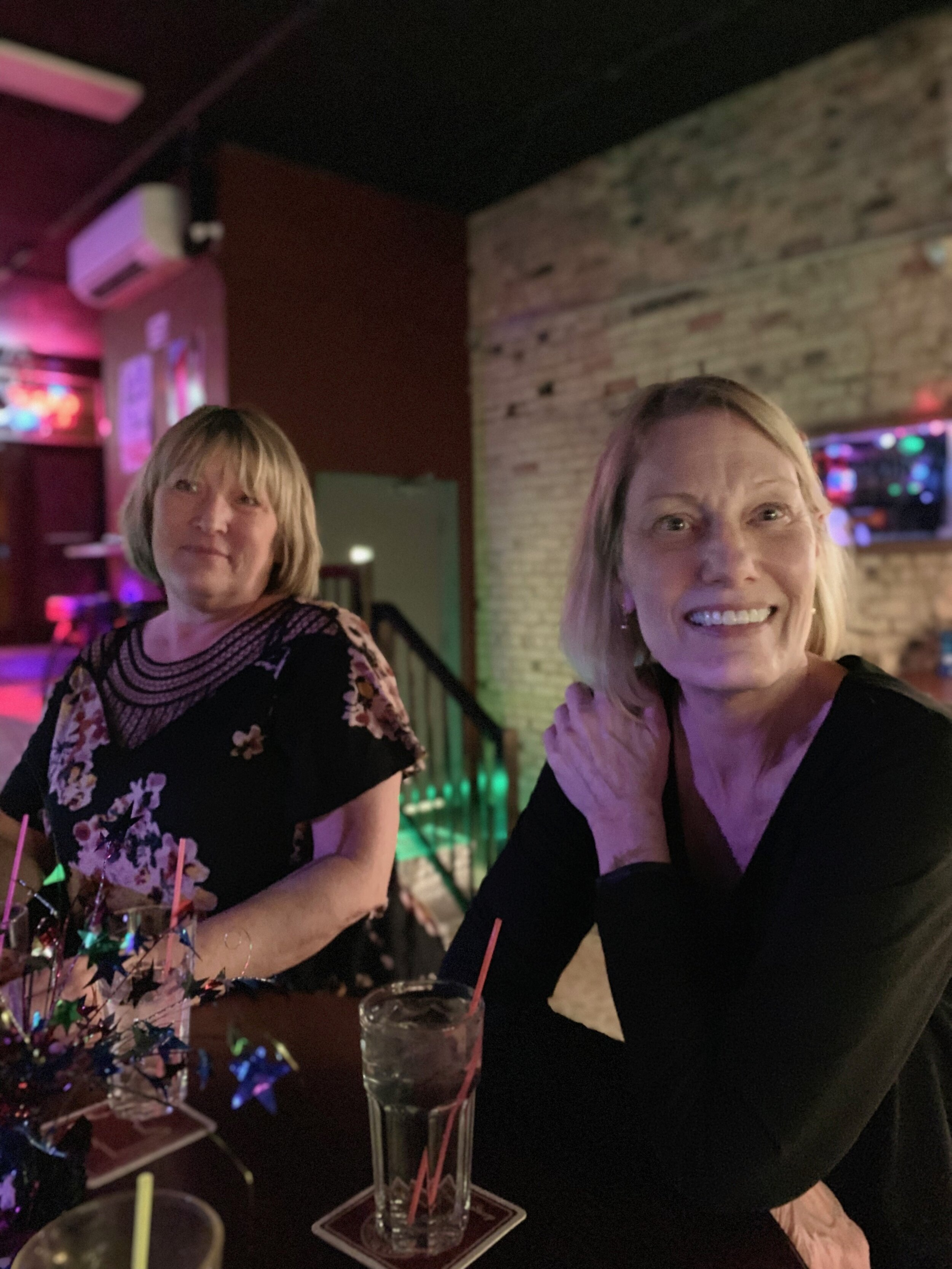 Pat Larson, right — sitting with her sister Armella Bitold, taking a break from swing dancing. Photo courtesy of Tyra Jaramillo.
