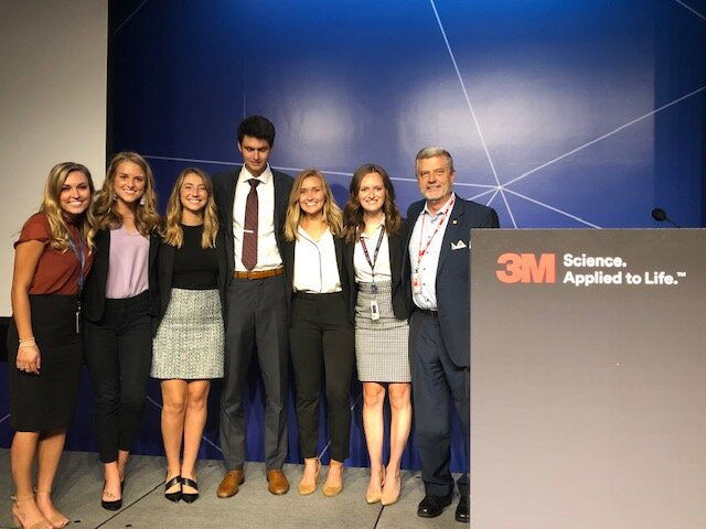 Labovitz School of Business and Economics' 2019 3M frontline interns with Marketing Instructor John Kratz. Pictured from left to right: Alexa Hilger-Sawochka, Kaylee Wallner, Lizzy Fontes, Charlie Crist, Molly Arbuckl, Eliza Ebel, John Kratz. Photo courtesy of John Kratz