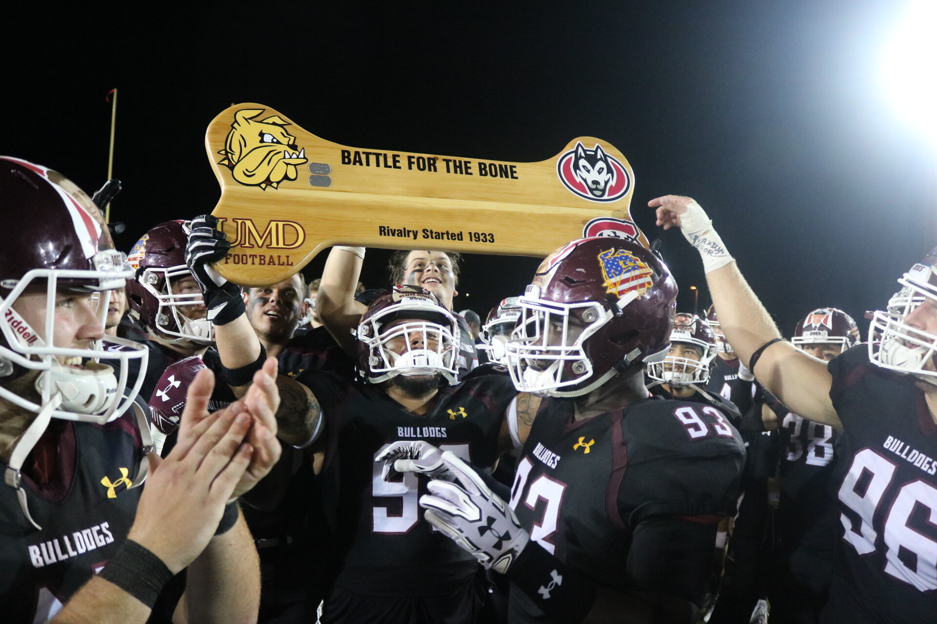 """The Bulldogs celebrate keeping """"The Bone"""" for another year following their 20-14 defeat of the St. Cloud State Huskies. (Photo courtesy of Drew Smith/UMD Athletics)"""