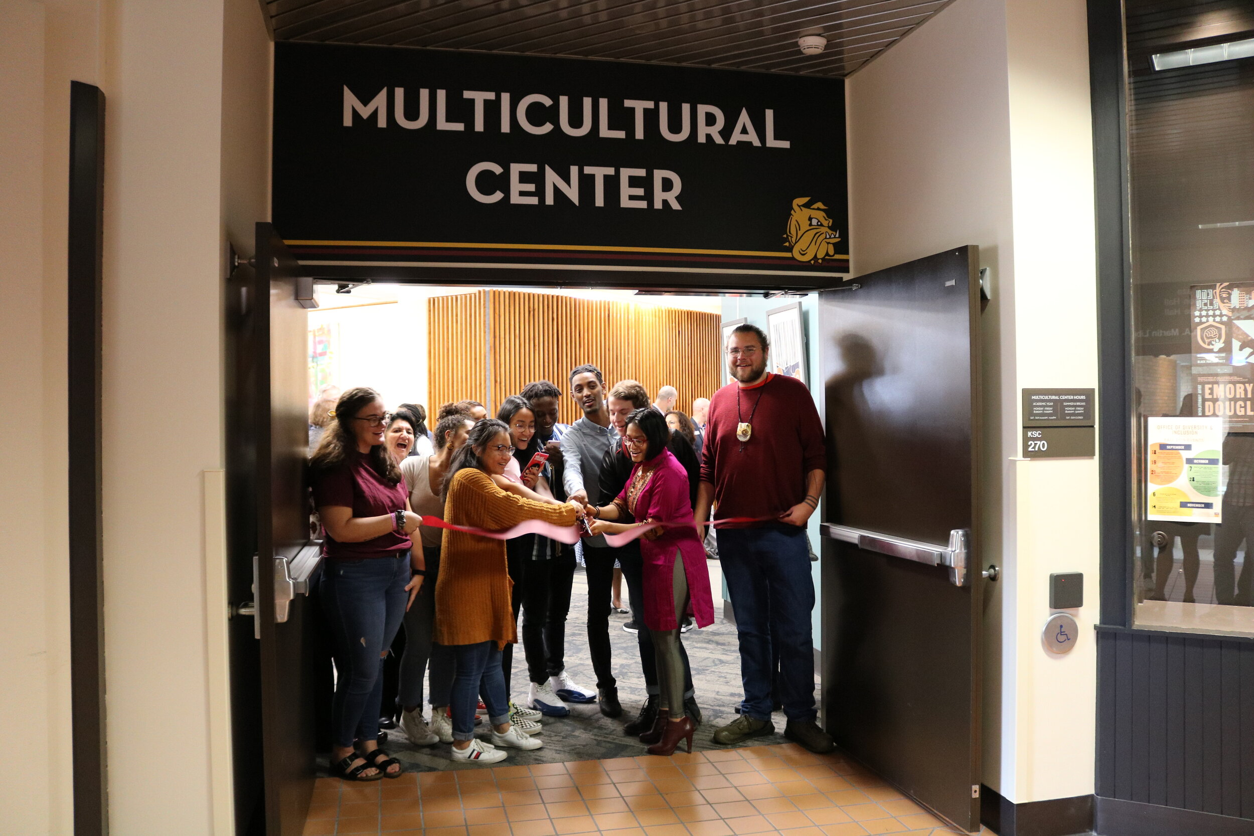 Students and faculty officially reopen the Multicultural Center with a ribbon cutting ceremony at the spaces main entrance. Photo courtesy Kirby Student Center