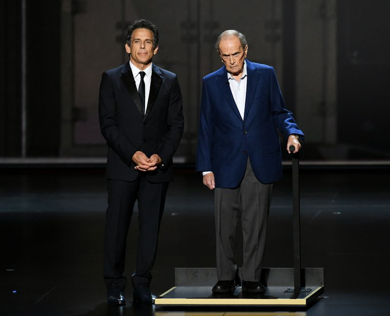 Ben Stiller standing next to Bob Newhart during a skit where Newhart reminded him he was still alive, after Stiller had walked through wax figures of other Comedy legends.  Photo Courtesy of the New York Daily News Website