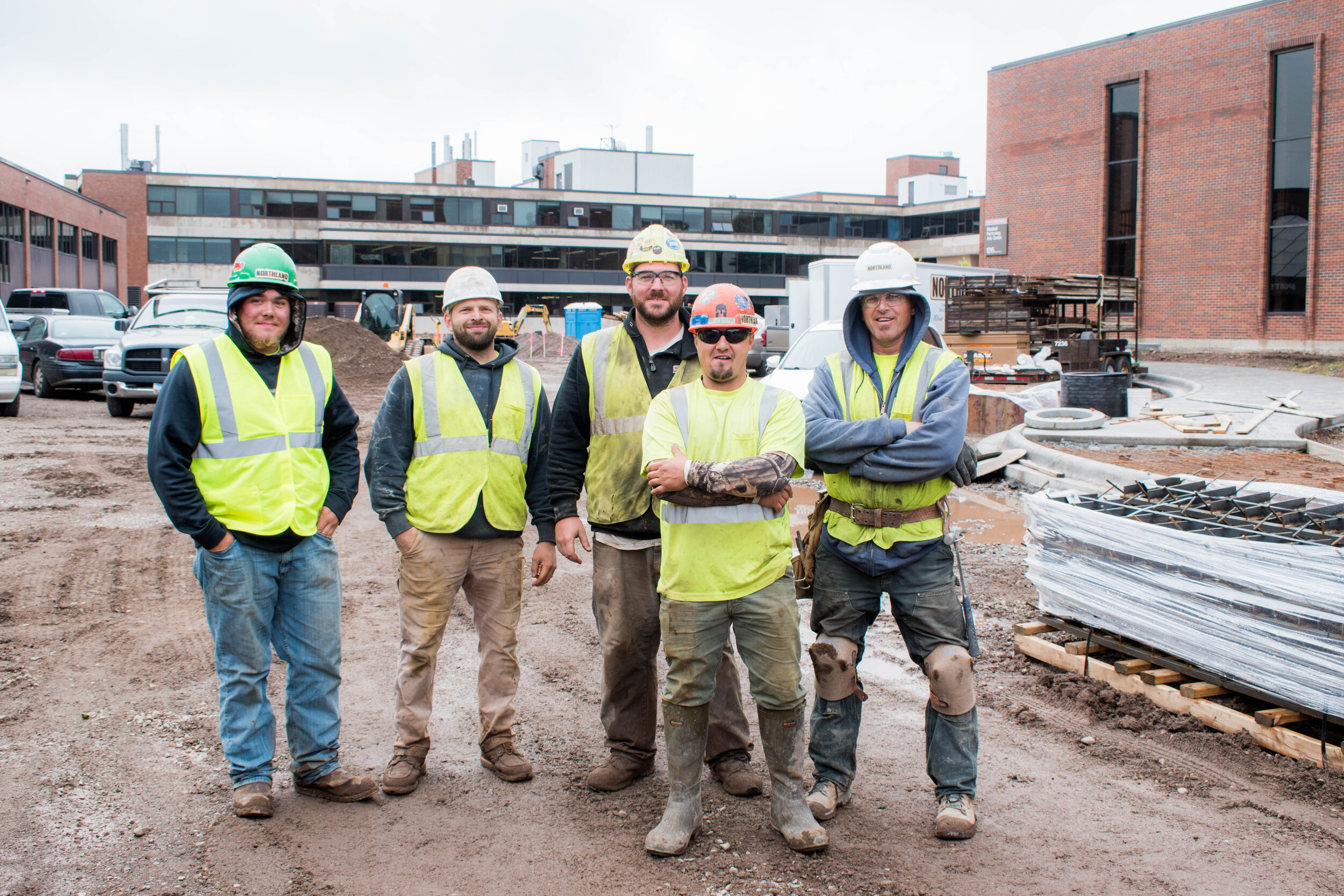 Construction Workers (From Left) Tony Moselle, Adam Wittrock, Jace Oien, Charlie Mccune, John Engbretson on site in Ordean Court. Photo by Karli Kruse