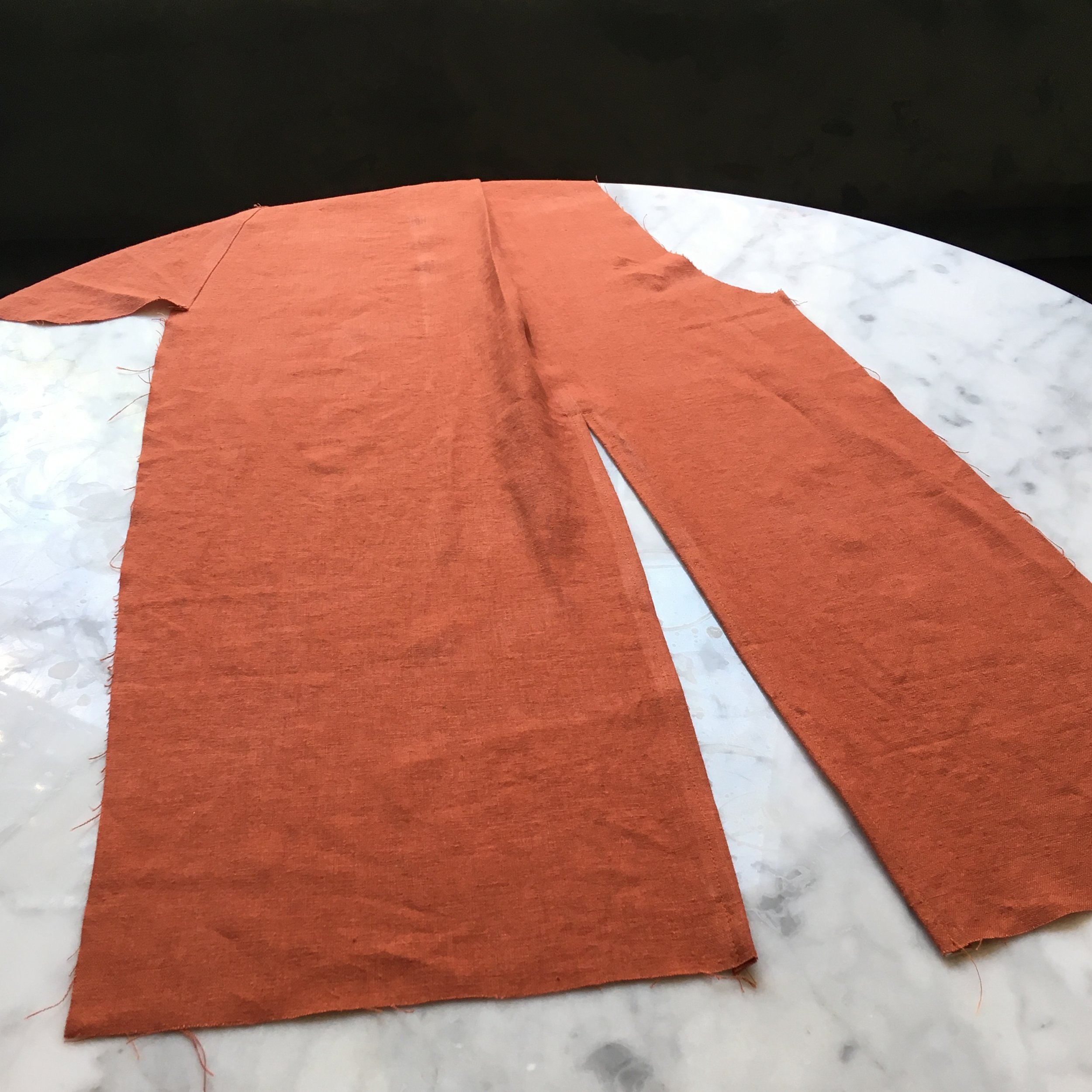 This is the completed front section of the pant that has a chic slip up the front reinforced by some clean top stitching.