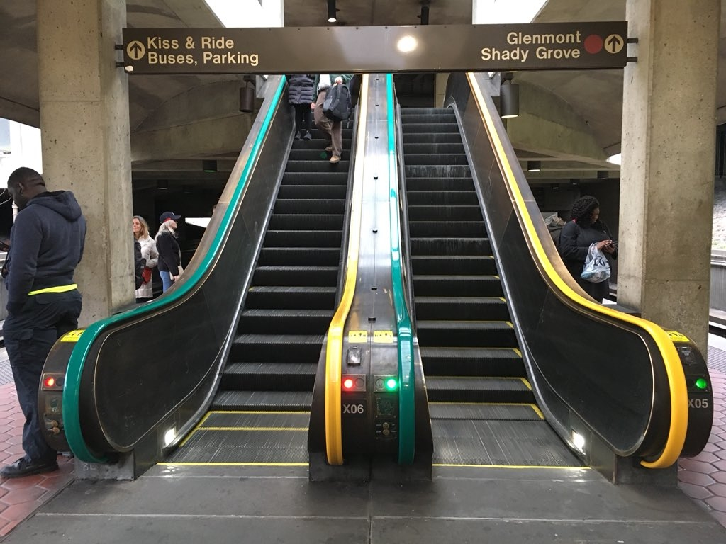Metro is testing out new color-coded escalator handrails at Fort Totten station