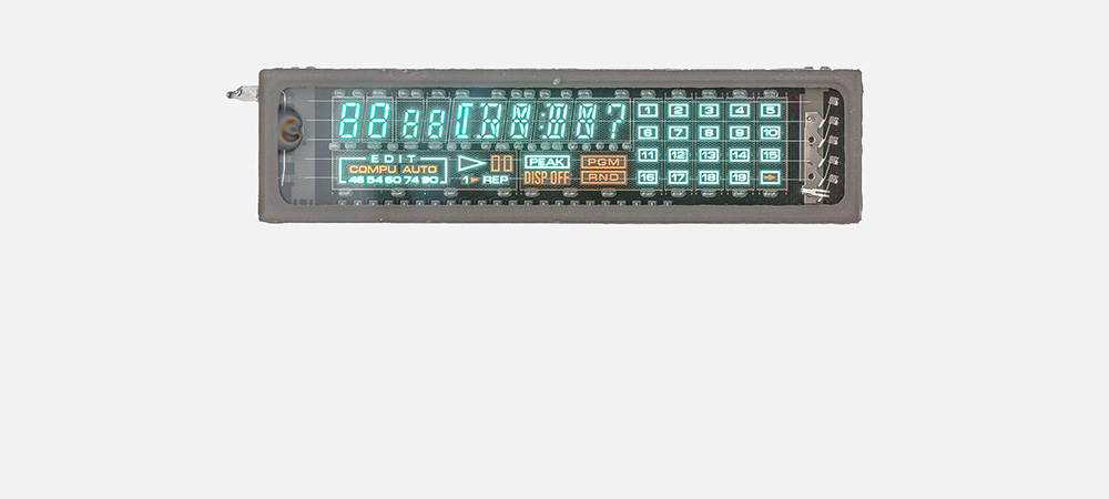 Say hi to an old friend:  The vacuum fluorescent display, a special vacuum tube developed in the 60s. They were popular for their futuristic teal glow with remarkable, distinctive brightness.