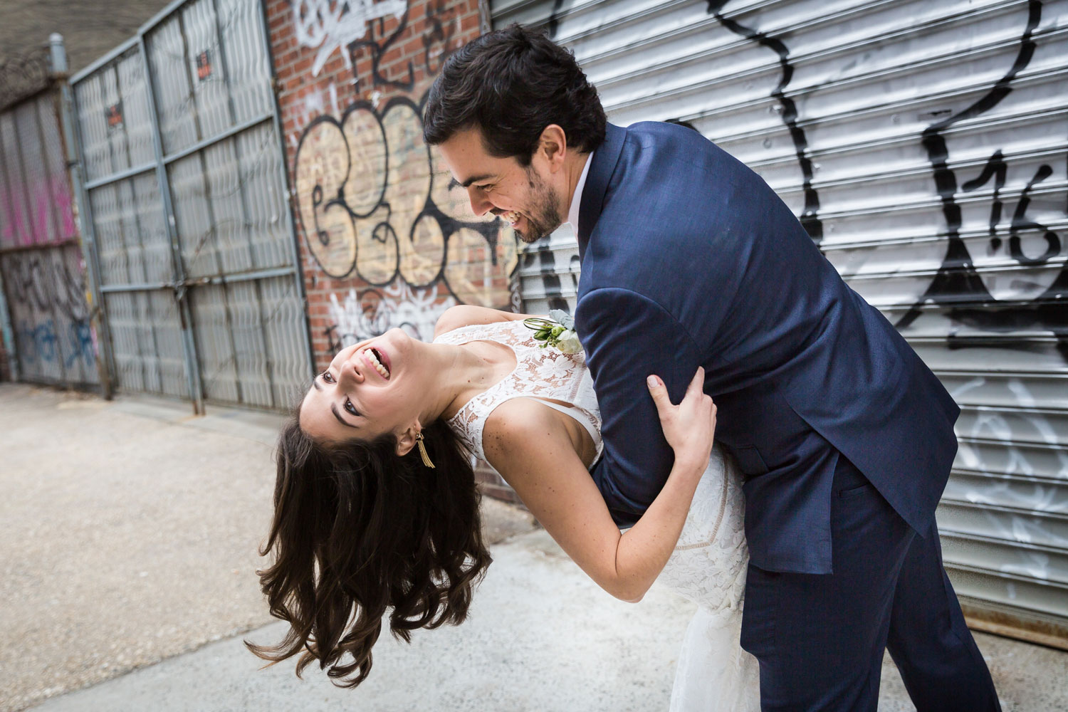 Bride and groom dancing on the street in NYC