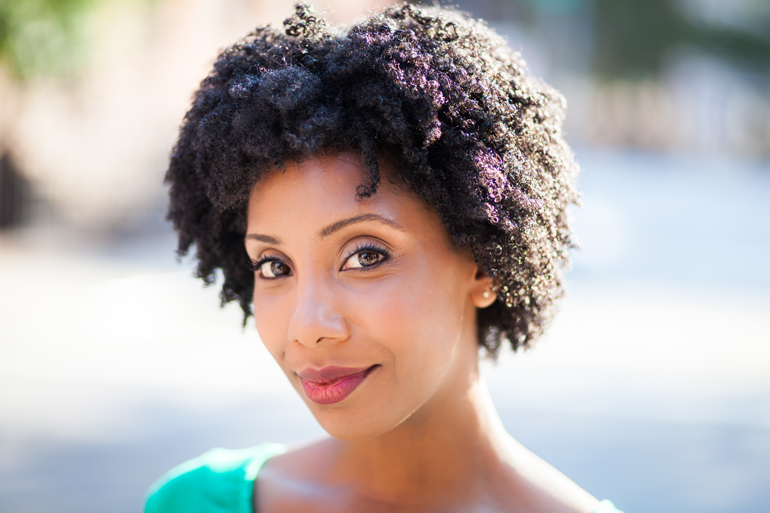 Model headshot of African-American woman with curly hair