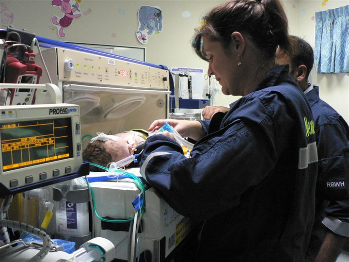 Neonatal Retrieval Team - Kate strapping Evan in for his trip to Royal Brisbane and Women's Hospital NICU ward.