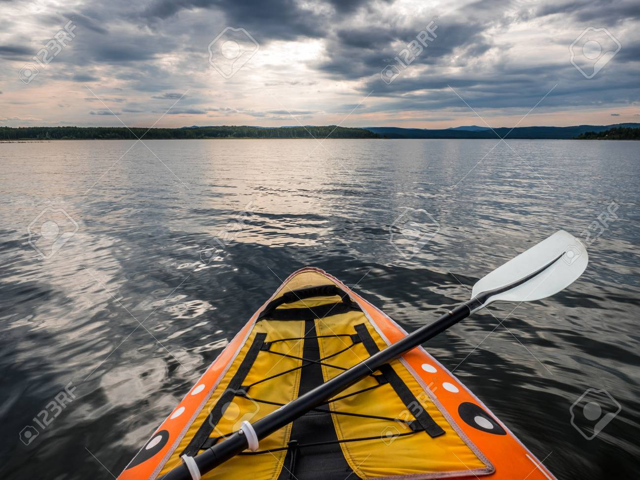 105707365-point-of-view-shot-from-inside-kayak-on-lake-water-.jpg