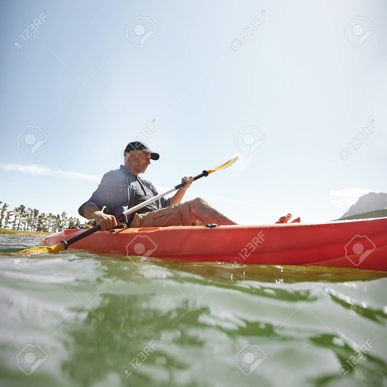 55357064-shot-of-senior-man-kayaking-on-lake-on-a-summer-day-mature-man-paddling-a-kayak-in-lake-.jpg