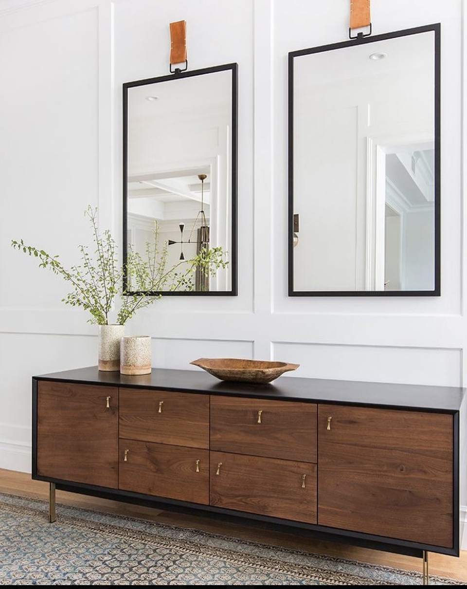 Source . I love how the organic shape of the wood bowl softens the otherwise very precise lines in this vignette. The Amber Interiors team knocked it out of the park with this design.