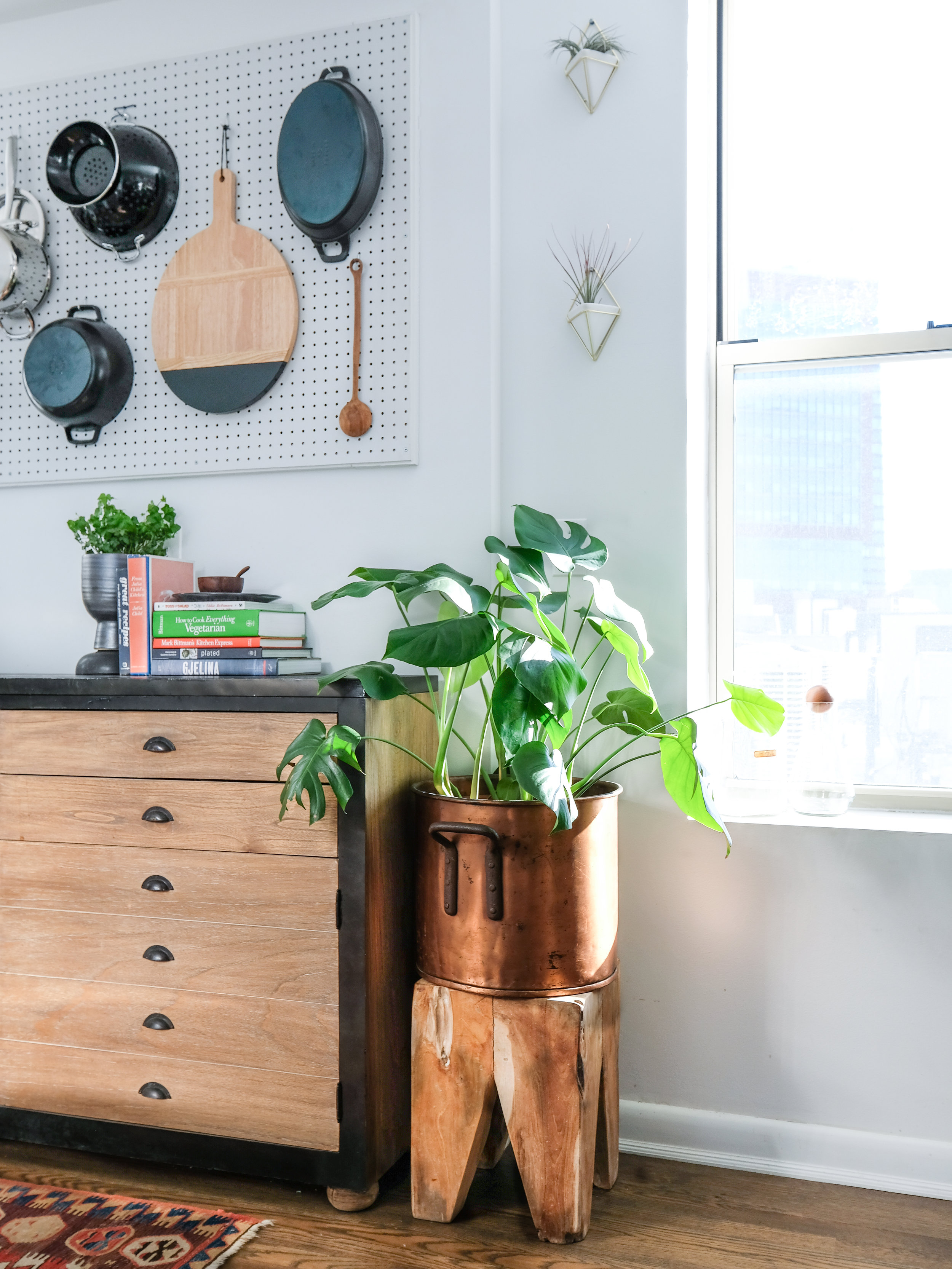 My beloved shallow dresser that doubles as a counter and much-need storage in my kitchen. The cutting board, ladle, woodblock stool, and carafe stopper are more wooden accents.