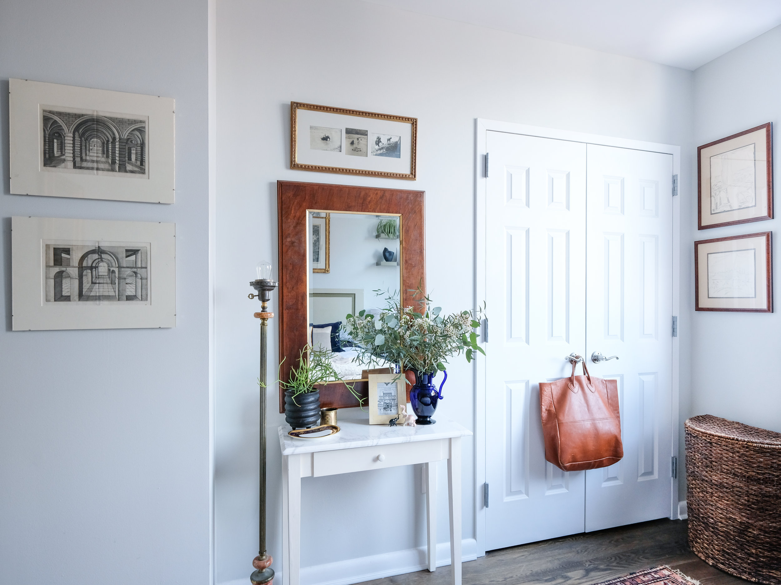 Wooden frames are another way to add this natural material to your space without it being over-powering.