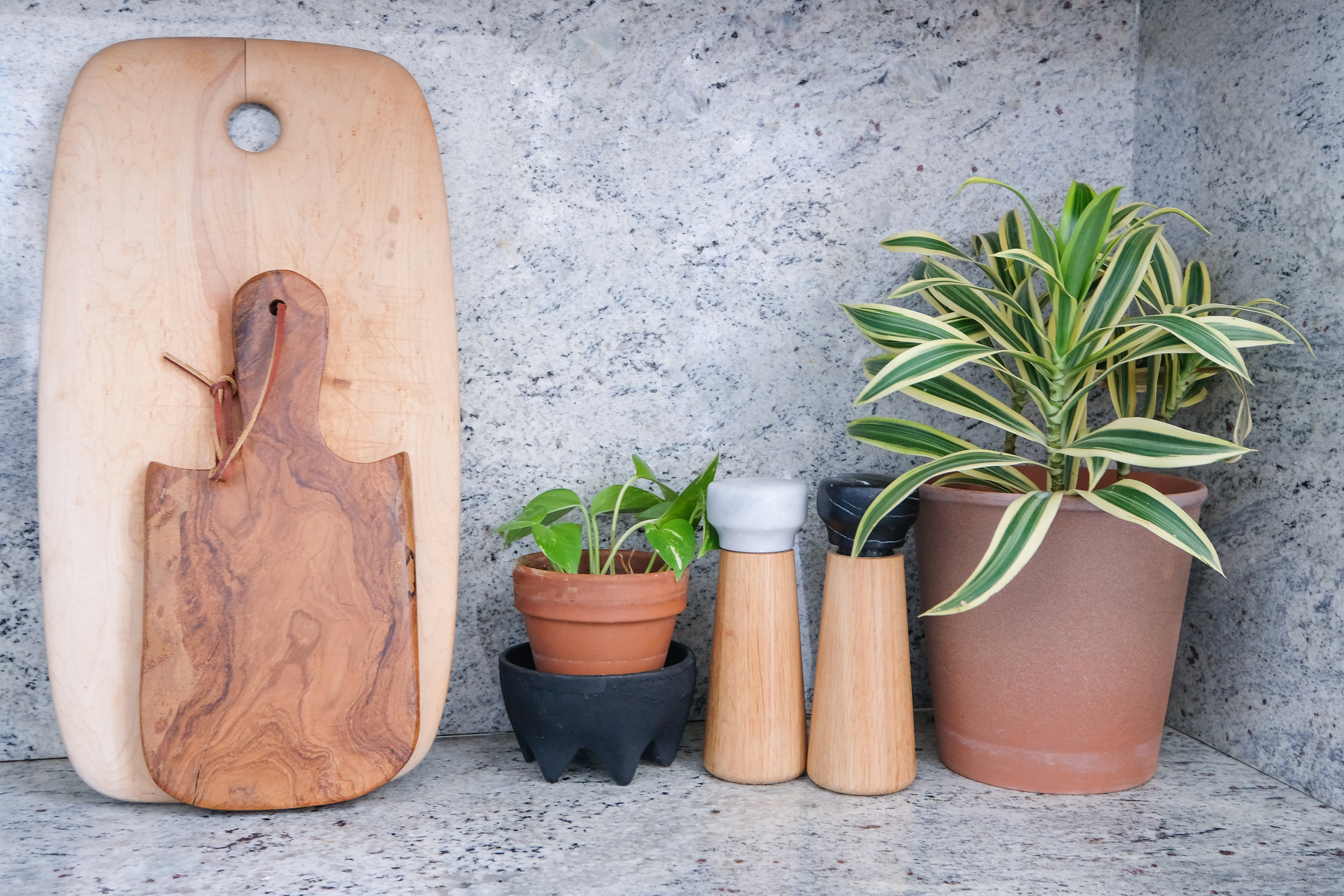 Displaying wood cutting boards in the kitchen is a favorite trick of mine. I also love these salt and pepper grinders with a wooden base.
