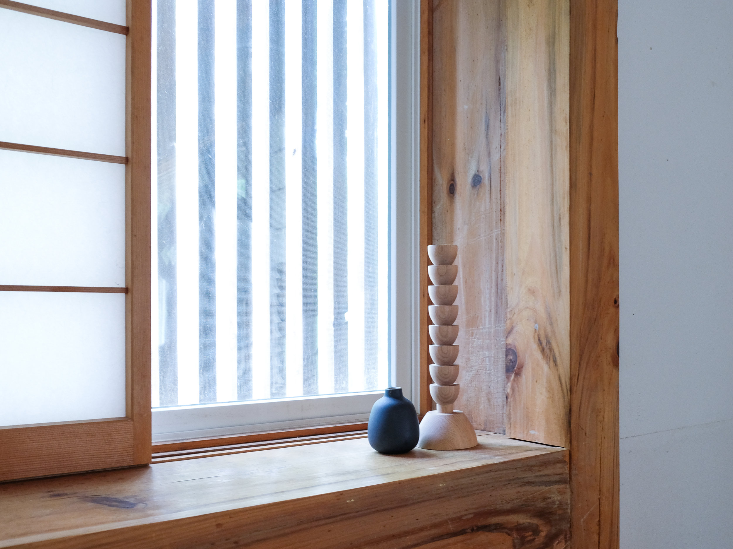 Last spring, Jeff and I stayed at a  Japanese-inspired cabin in the Catskills  that was filled with wood accents. You can see a similar taper holder in the product round-up below!