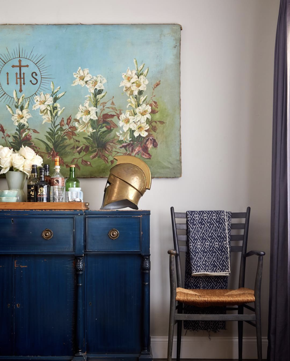 Source . I love the idea of using a helmet like this as sculpture and this entire corner is perfect.