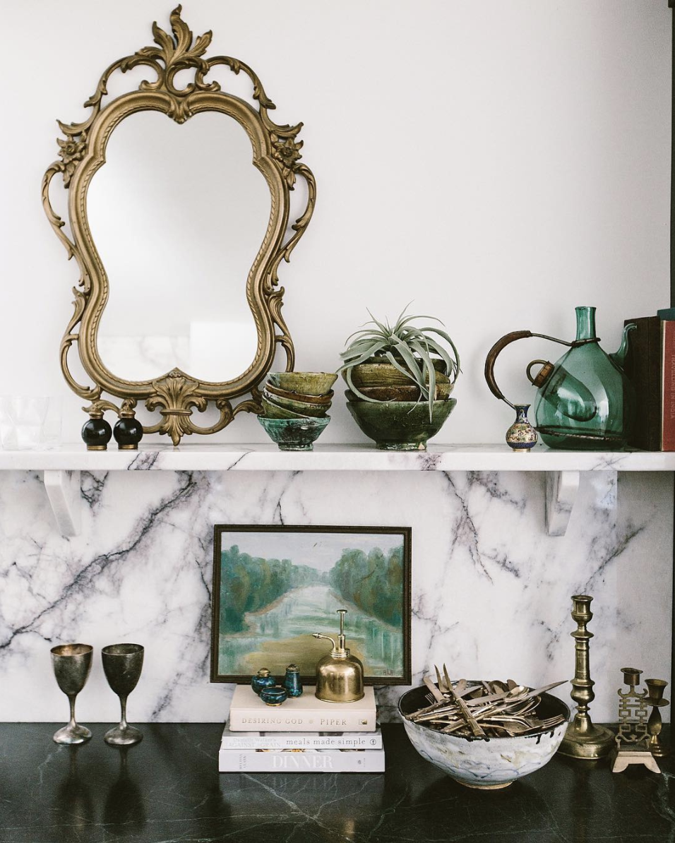 Source . Gold frames and accents like candle sticks are some of my favorite ways to incorporate metallics into decor.