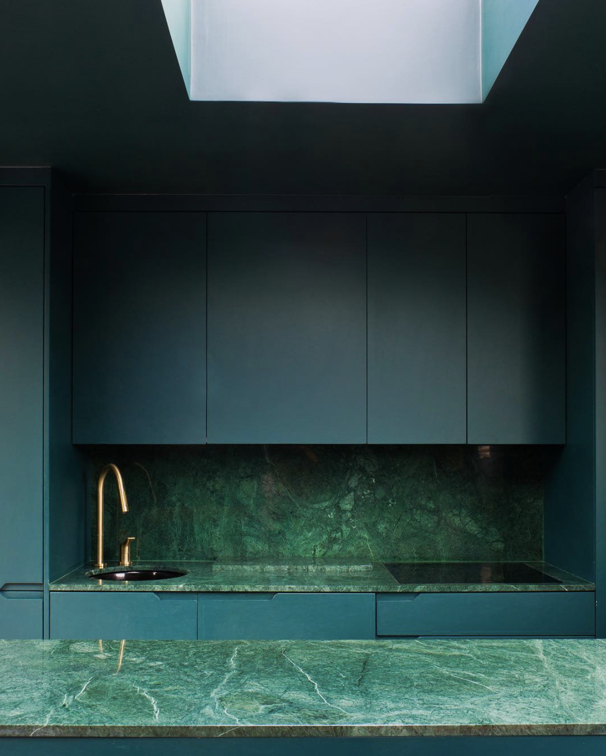 Source . Now THIS is how you do a green kitchen. I love every single risk taken here and want to cook up a storm in this jewel box. Green kitchens are everywhere these days, but the green marble is a fun spin on that trend instead of just incorporating green with paint.