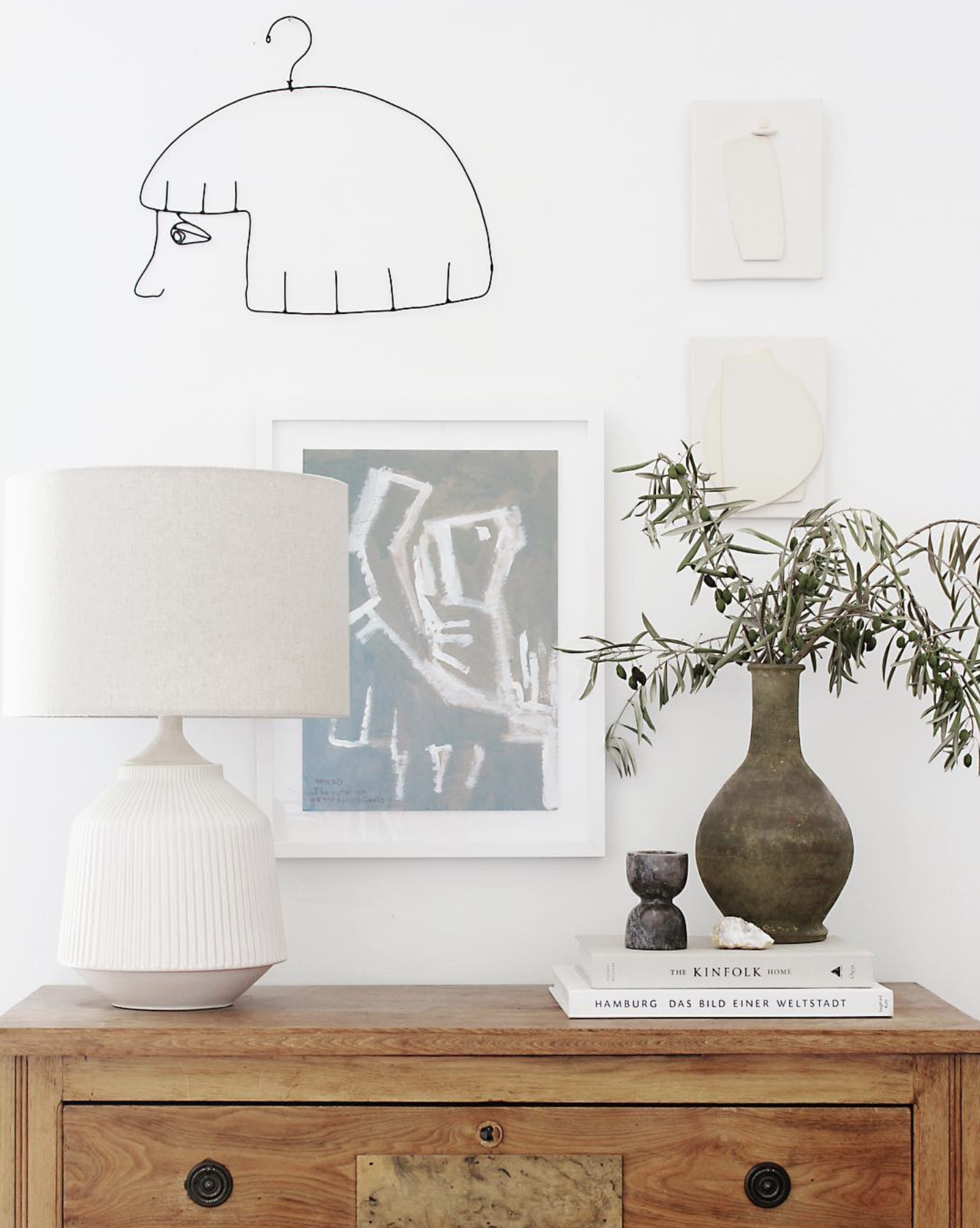 Source . Ceramics add a lot to this gorgeous vignette.