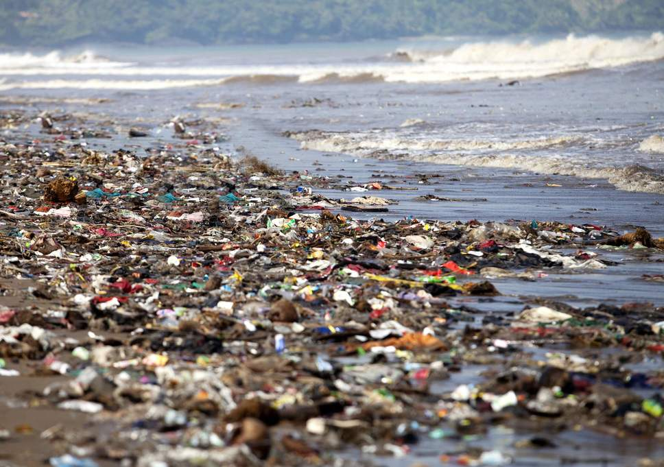 A once pristine beach now covered in plastic pollution and waste.