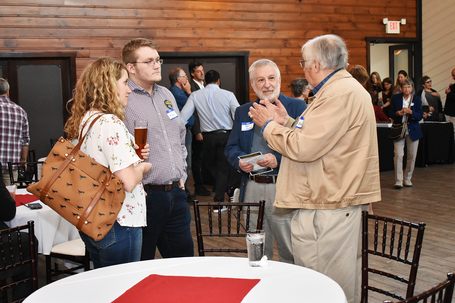 Attendees discussing Kimberly's run for Senate.