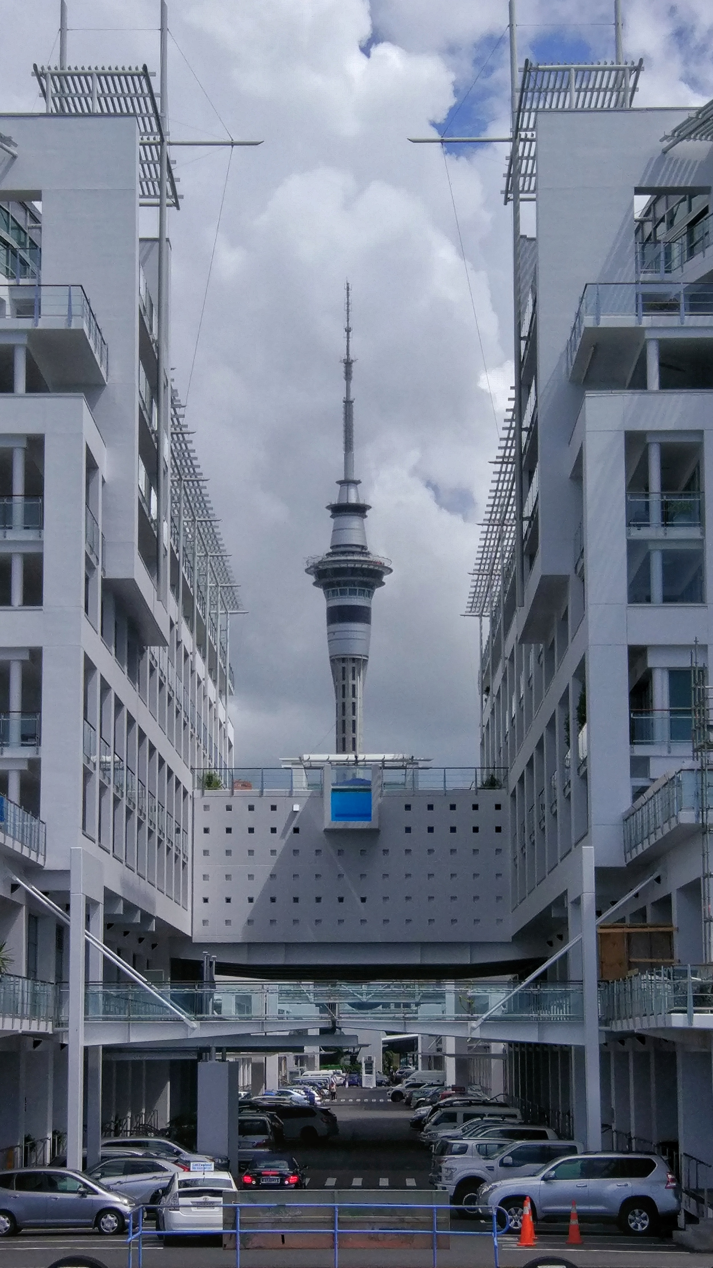 Sky tower AUckland in perfect symmetry with the hilton hotel!