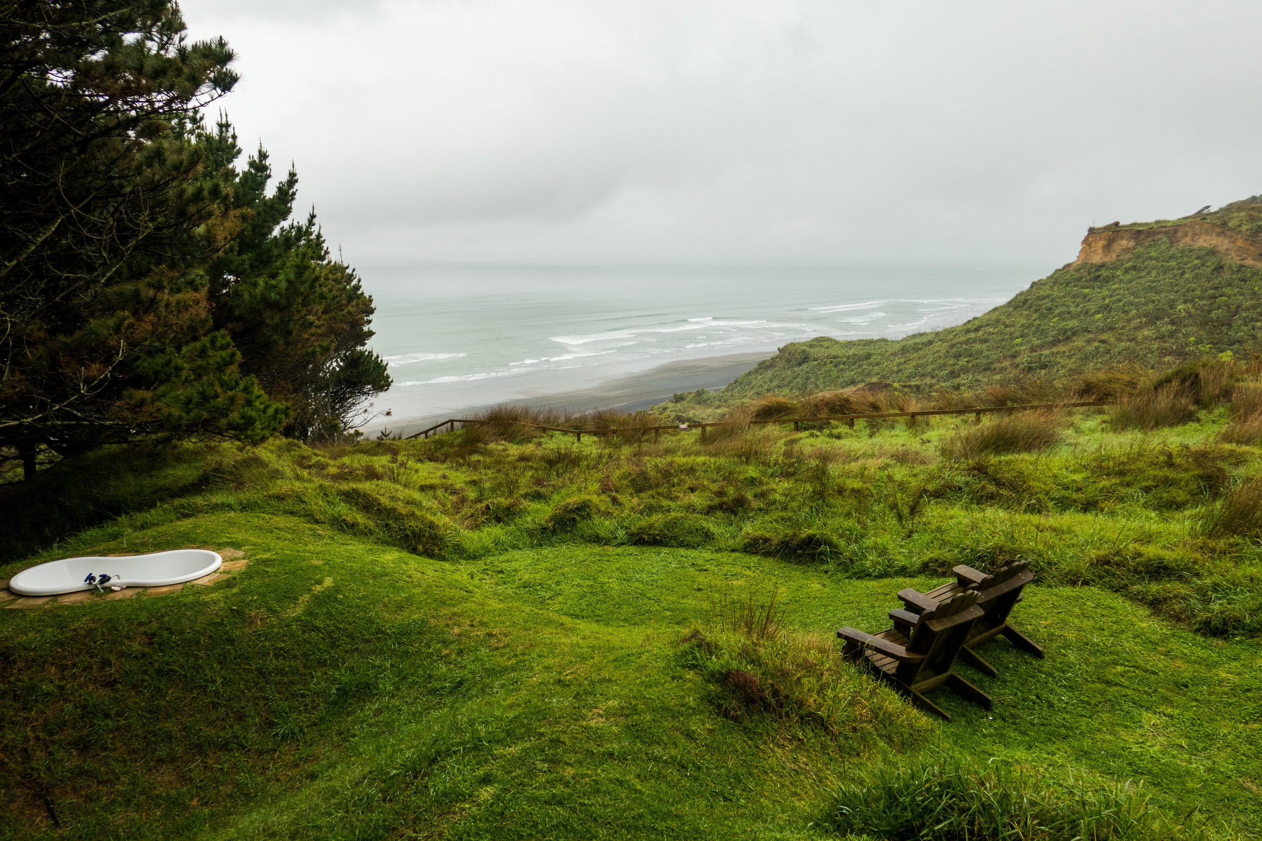 View over Karioitahi Beach near Auckland from our glamping hut. Note the awesome bath tub just for us
