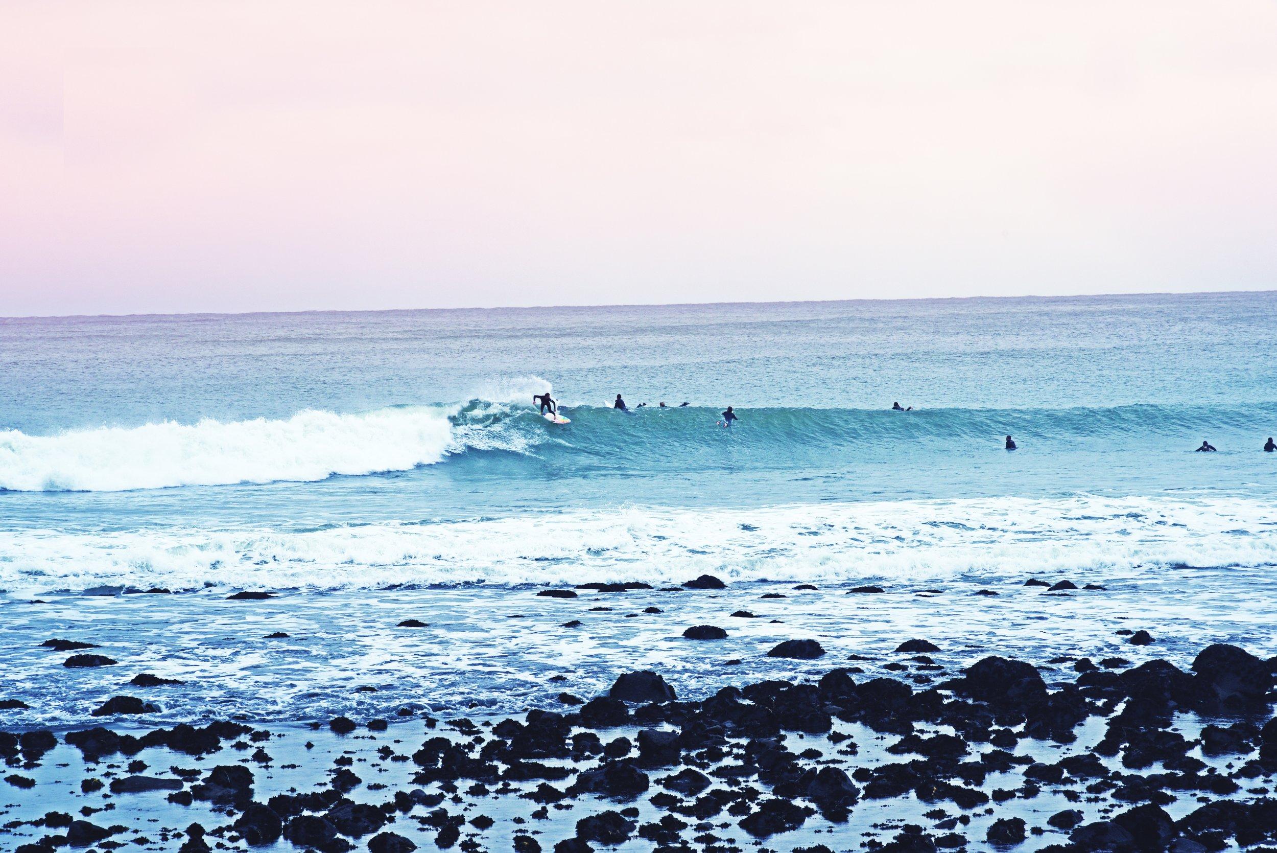 Surfer in Raglan. Photo by  anja.  on  Unsplash