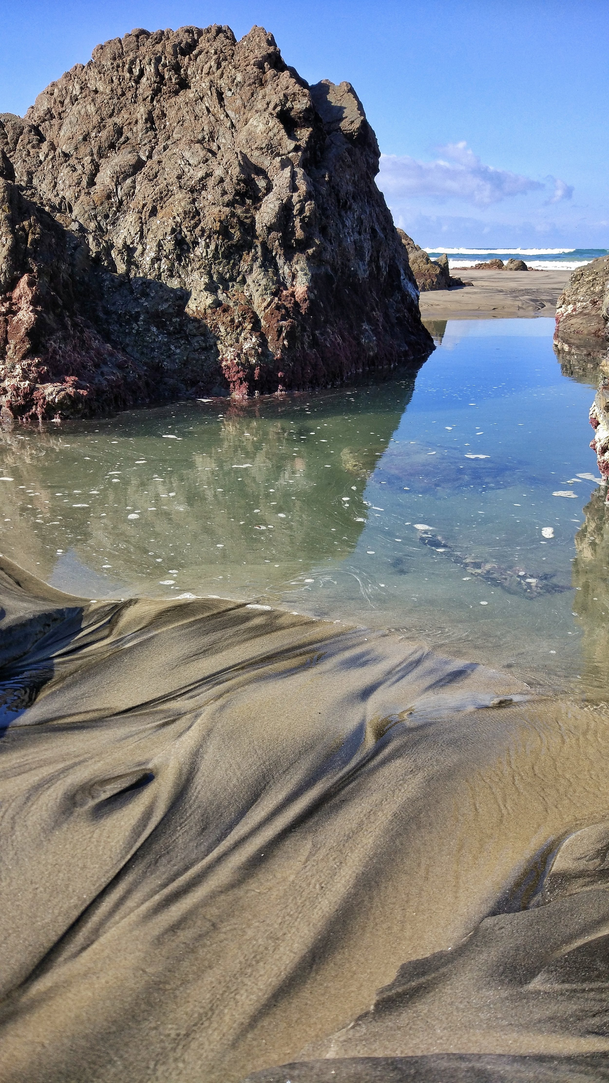 Rock pools and sand patterns at low tide