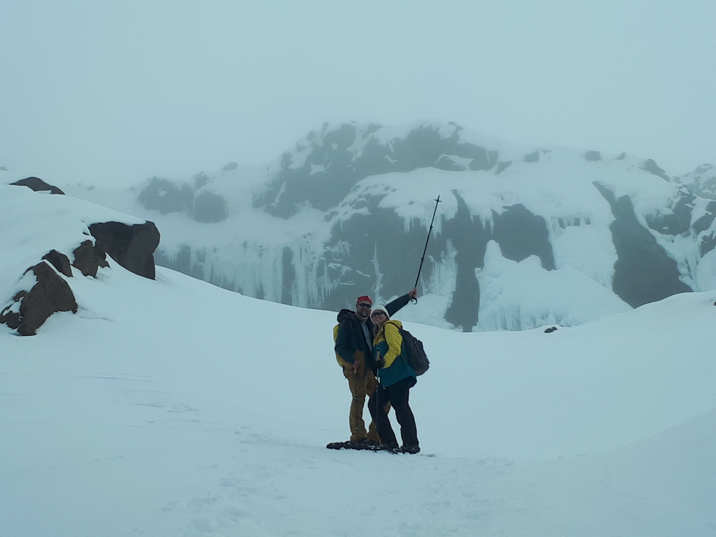 we're Posing in front of an icy waterfall: Snowshoe walking tour with chris jolly outdoors