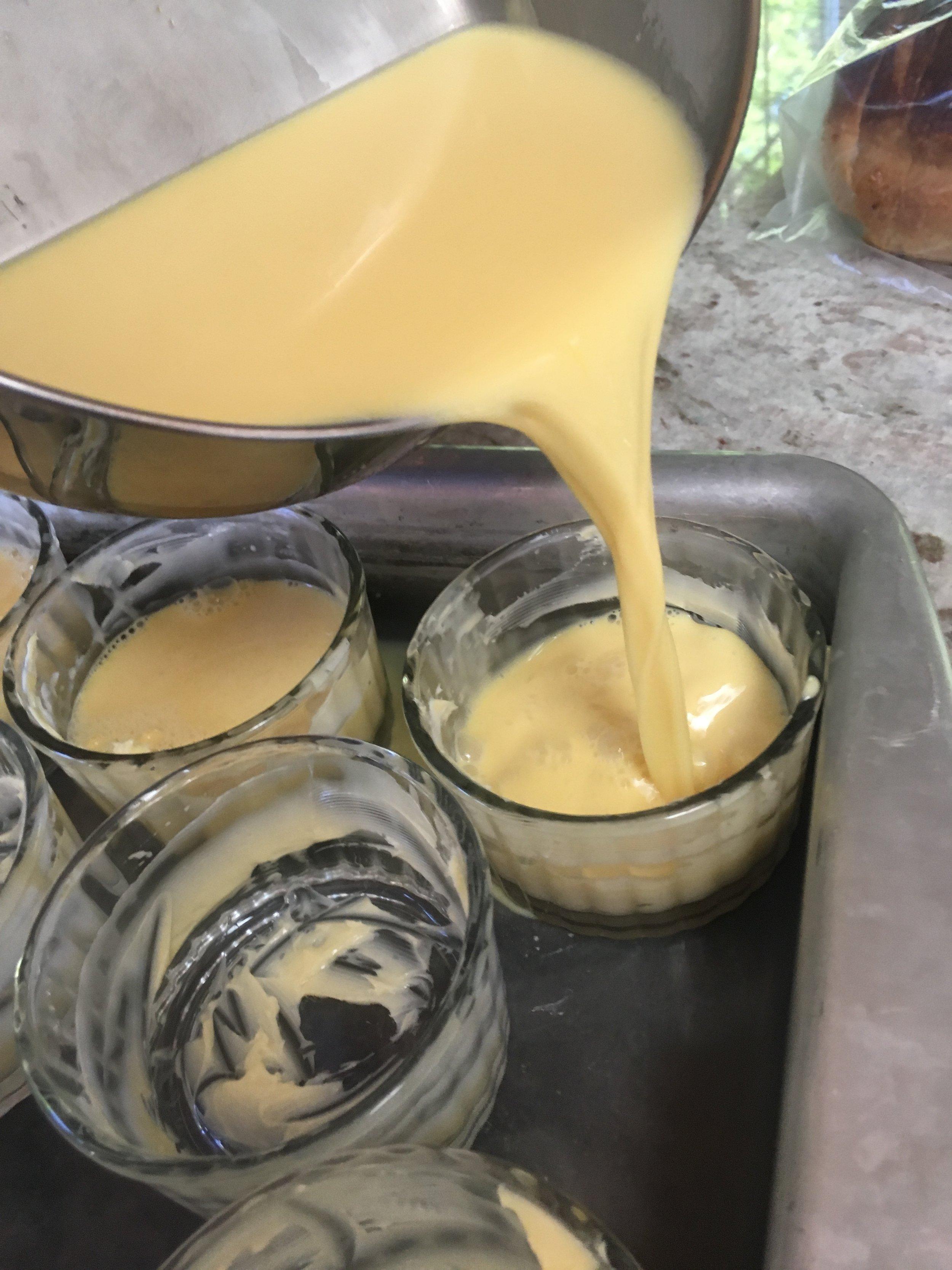 Pour custard mix into buttered ramekins