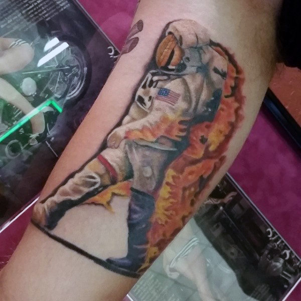 astronaut-on-fire-tattoo-mens-arms.jpg