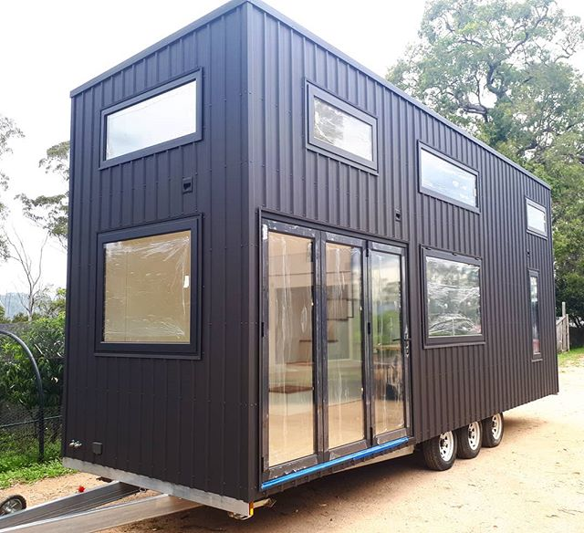 Sam and Isabel's beautiful custom contemporary 8m Sowelo Tiny House. Heading off to its new home in Tasmania. Double glazed windows and doors, fully insulated floor, walls and roof. With some amazing features including gas struted servery window and a Heat exchange unit.  www.sowelotinyhouses.com.au #sowelotinyhouses #contemporaryachitecture #minimalism #tinyhouseonwheels #australiantinyhouses #tinyhouses #architecture #livingbiginatinyhouse #Tinyhousesaustralia #awardwinning #awesome #tiny
