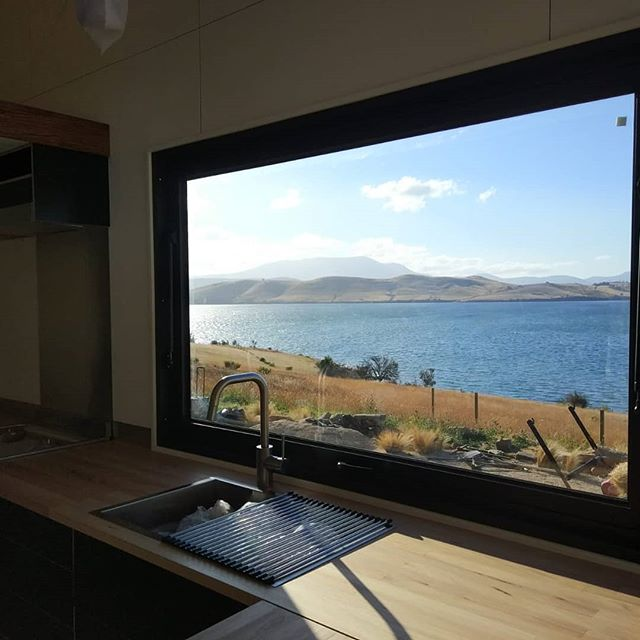 What a stunning view from Sam and Isabel's kitchen servery window, in Tasmania.  Opening 90° with gas struts for easy operation.  www.sowelotinyhouses.com.au #sowelotinyhouses #australiantinyhouses #tinyhouseonwheels #minimalist #minimalism #sustainable #smallspaces #lowimpact #ecobuild #ecoliving #awardwinning #contemporarytinyhouse #architecture #airbnb