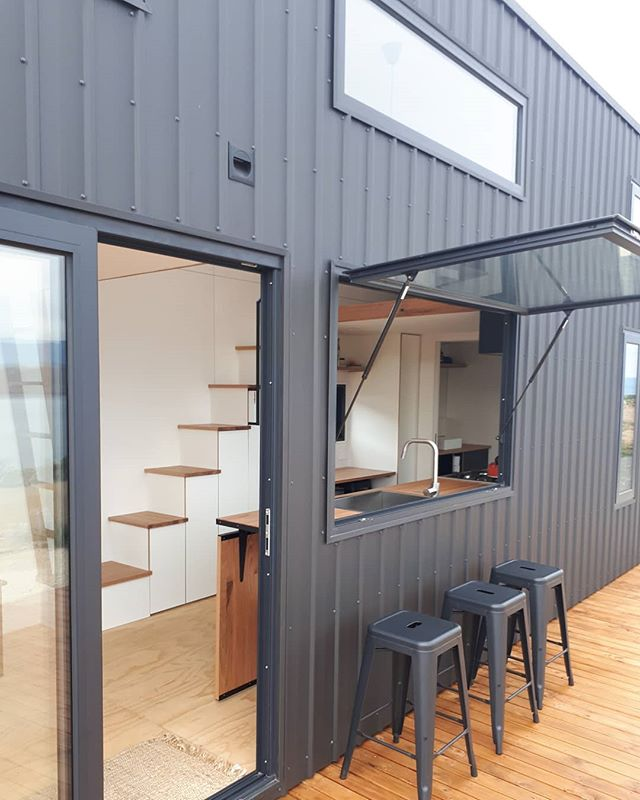 Matt Colourbond exterior and double glazed bifold doors and gas strutted awning window. www.sowelotinyhouses.com.au #sowelotinyhouses #livingbiginatinyhouse #minimalist #tinyhouseonwheels #australiantinyhouses #affordablehousing #tinyhomes #tinyhomesaustralia #tinyhousecitizens #newlife #newbeginings