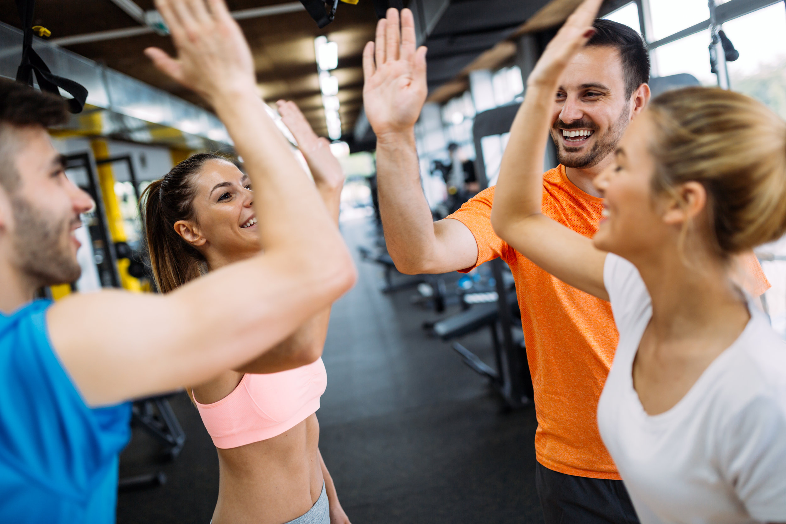 happy-fitness-class-giving-high-five-after-WR58HUZ.jpg